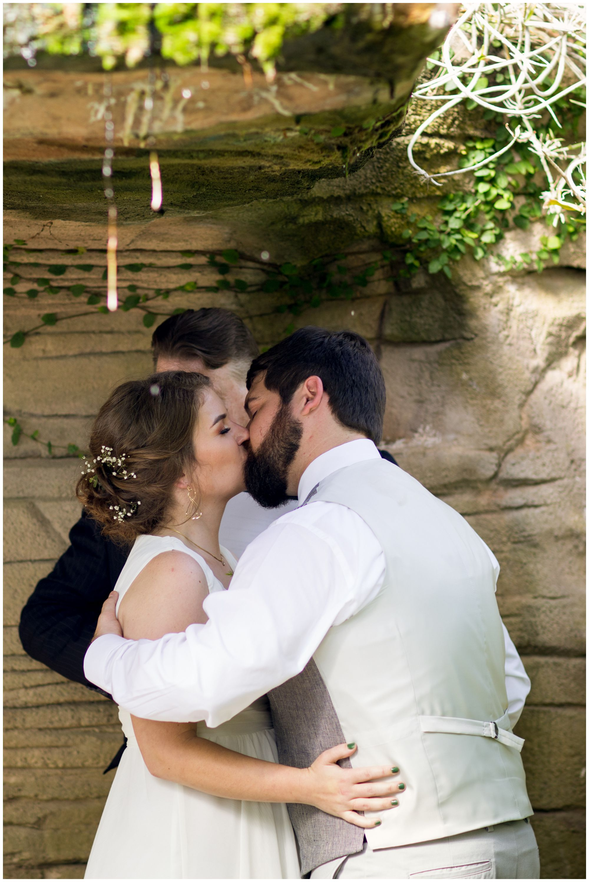 bride and groom first kiss after Garfield Park Conservatory Indianapolis elopement
