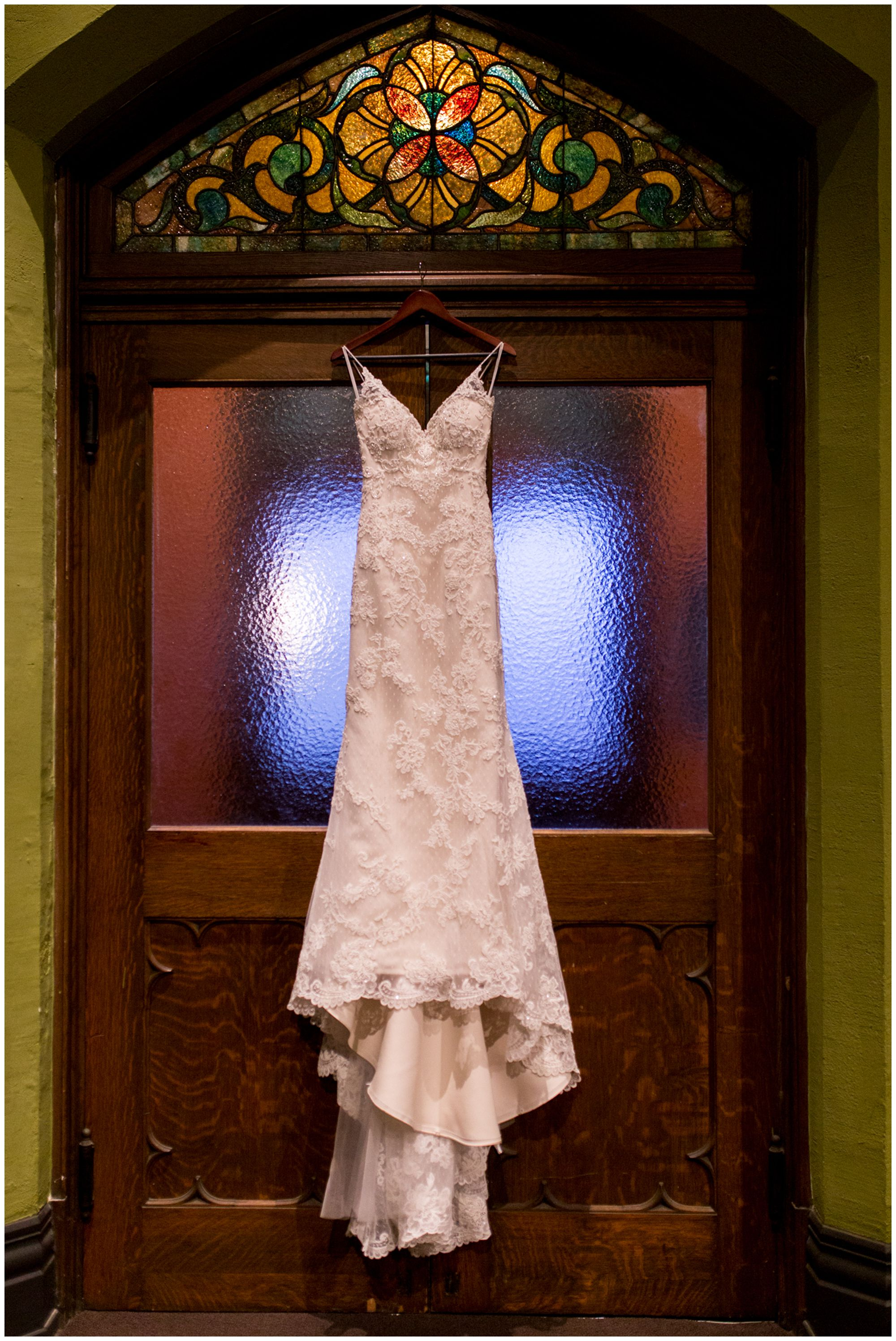 bride's wedding dress hanging from doorway at Redeemer Presbyterian Church Indianapolis