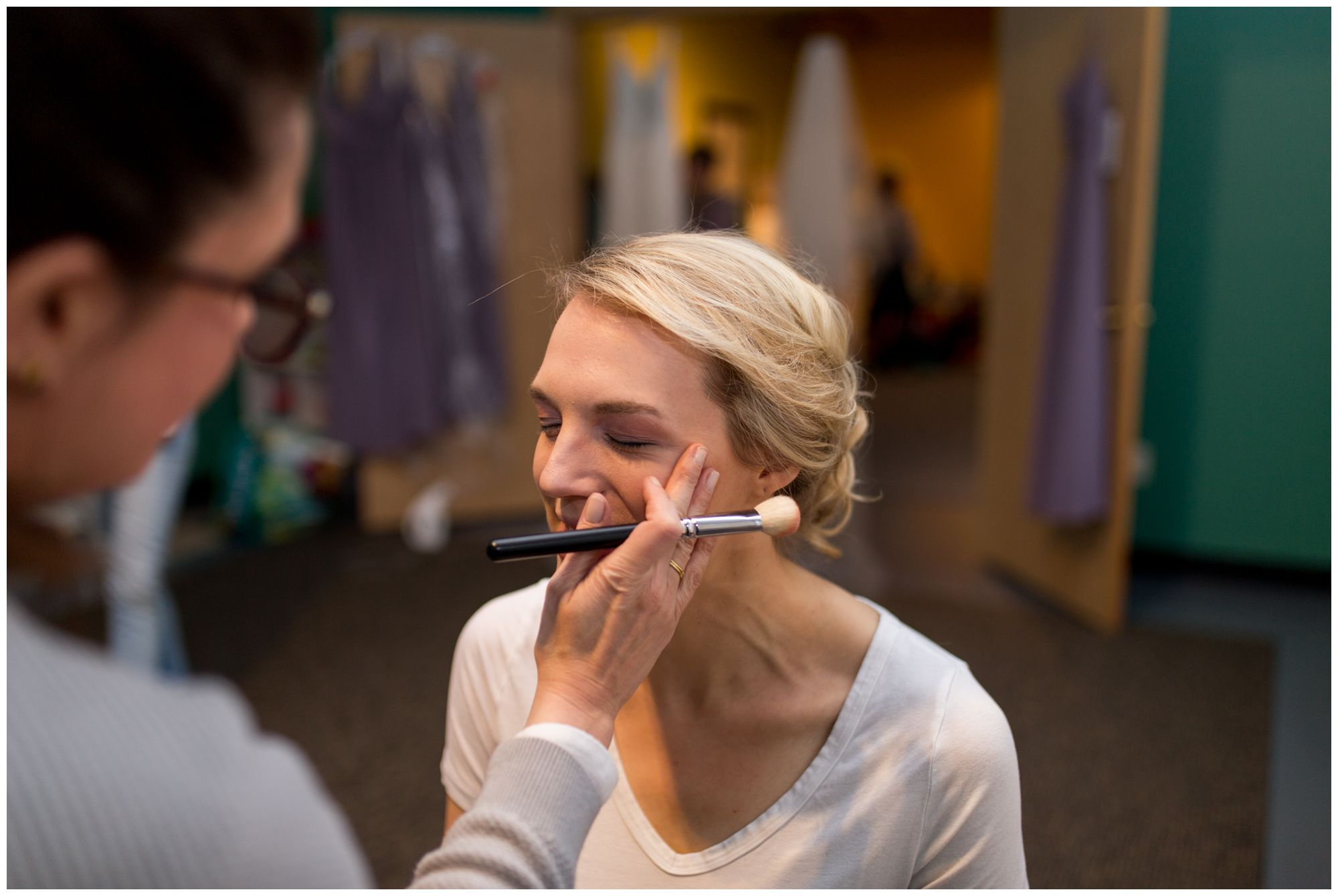 bride getting makeup done before Indianapolis wedding at Redeemer Presbyterian Church