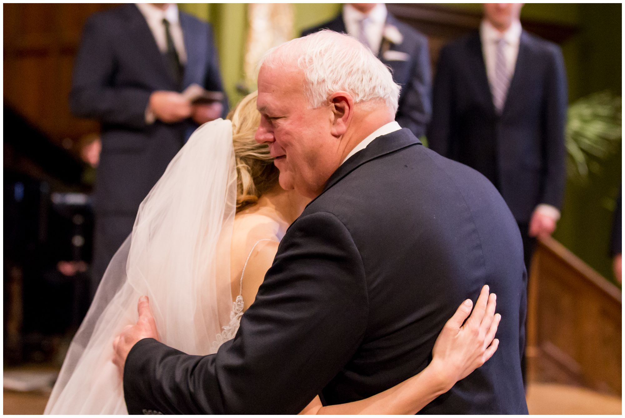bride hugs father during Redeemer Presbyterian Church Indianapolis wedding