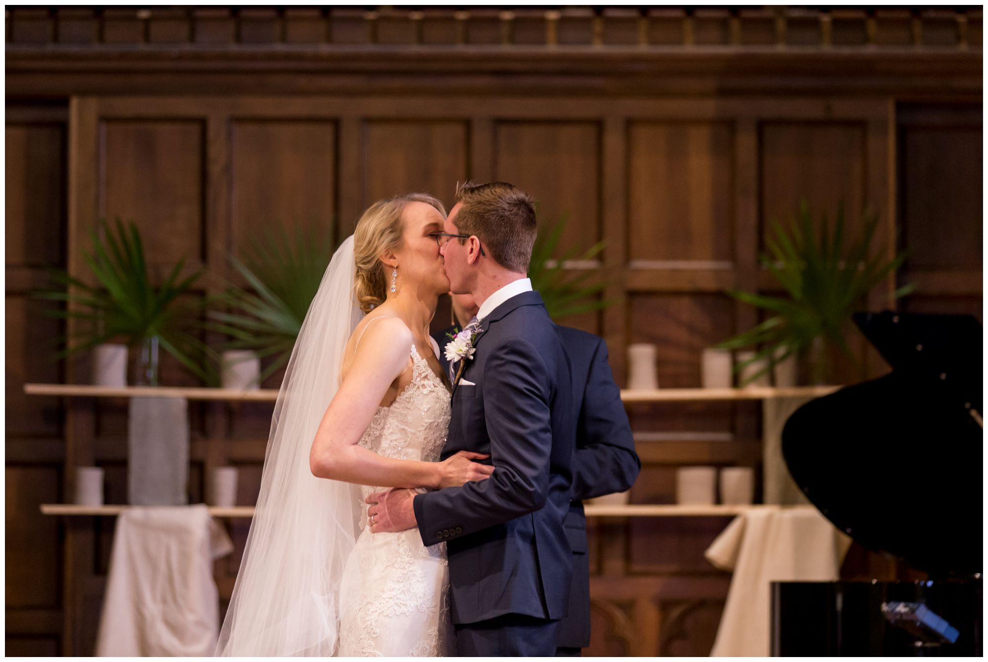 bride and groom first kiss during Redeemer Indy wedding ceremony