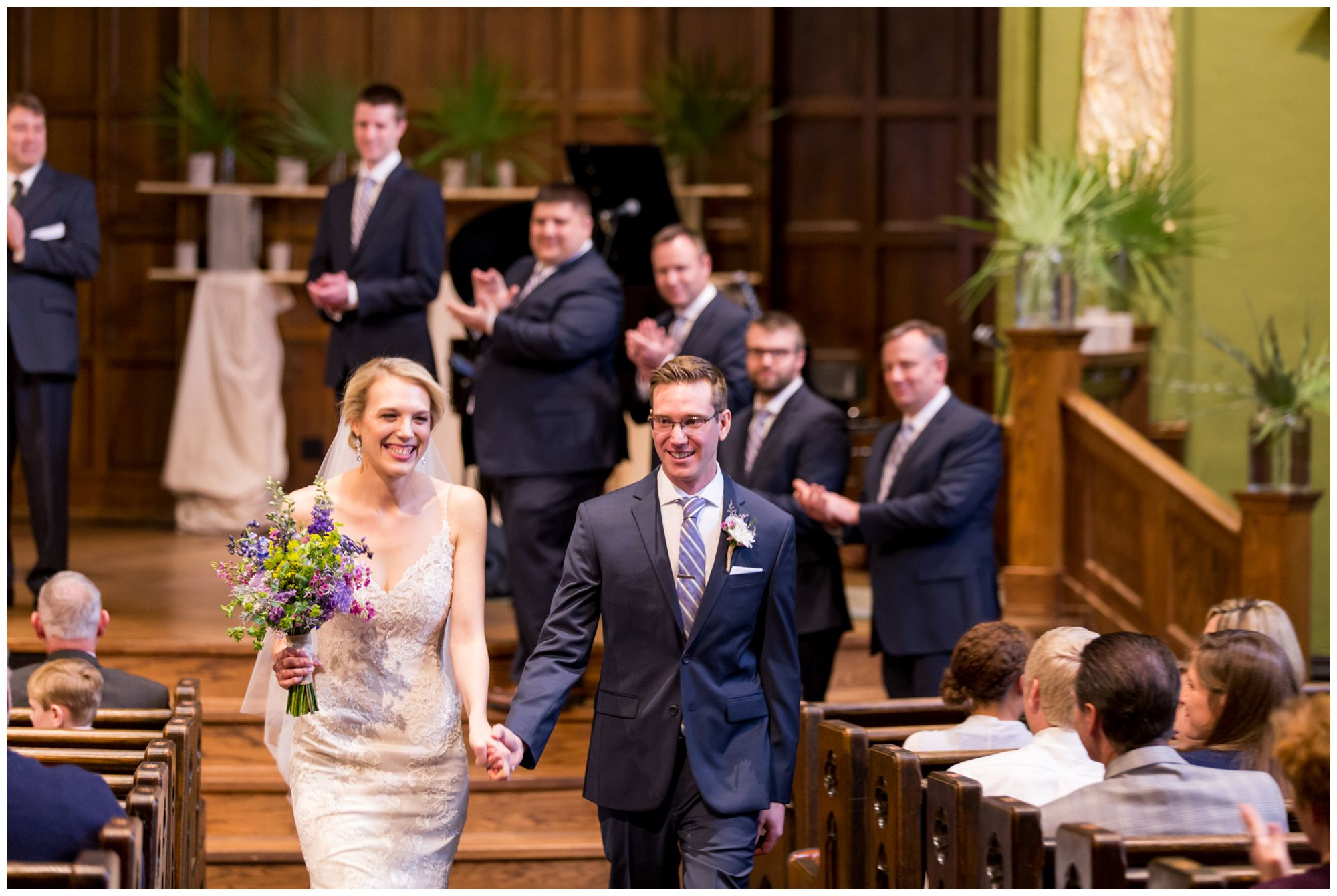 bride and groom leaving wedding ceremony at Redeemer Presbyterian Church in Indianapolis