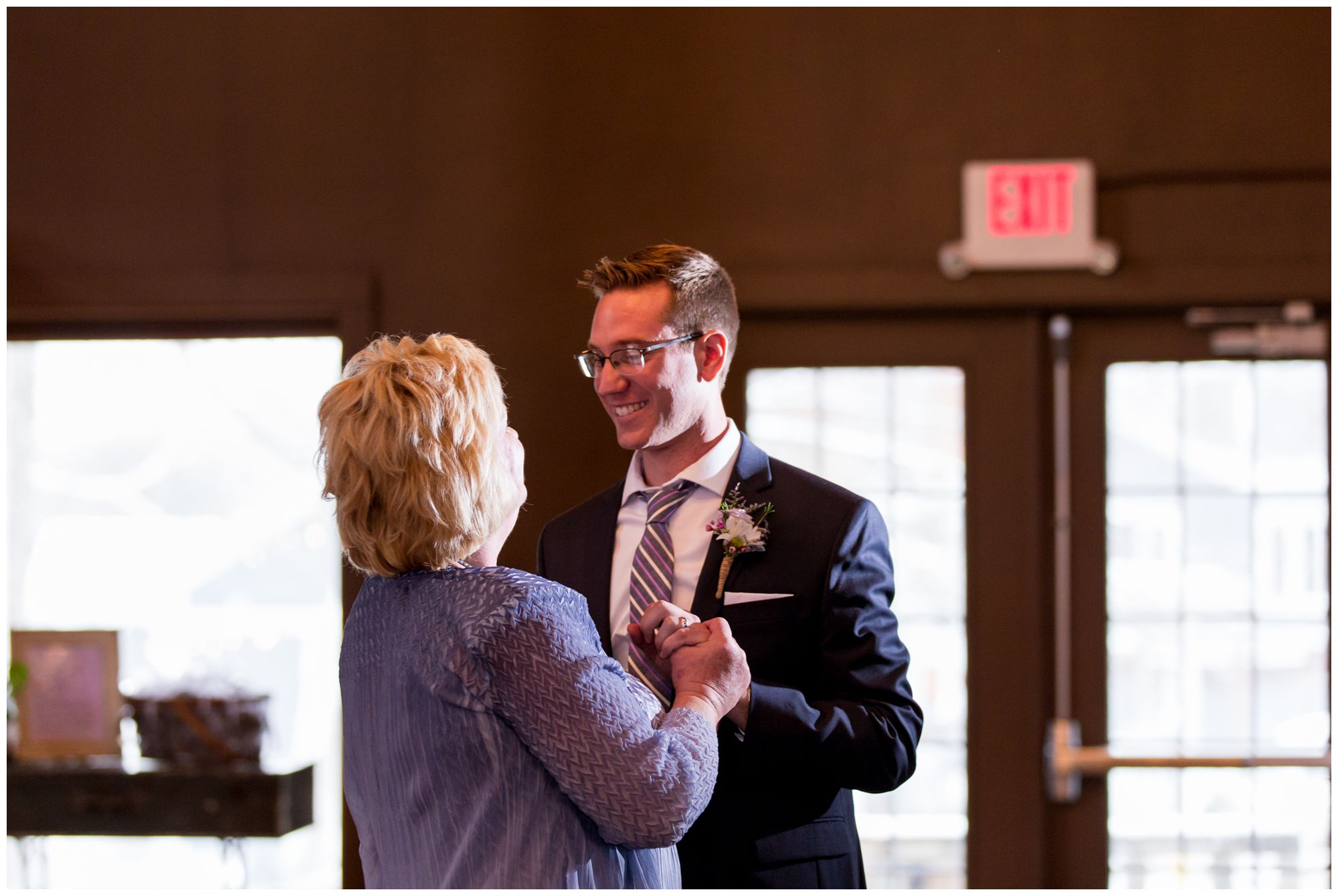 groom and mother dance during wedding reception at Mustard Seed Gardens in Noblesville Indiana