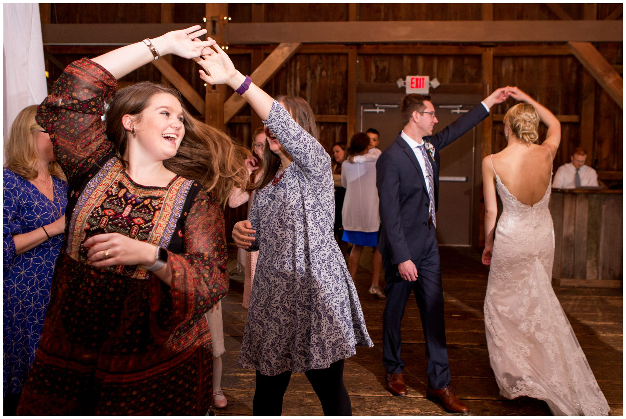guests dance during wedding reception at Mustard Seed Gardens in Noblesville Indiana