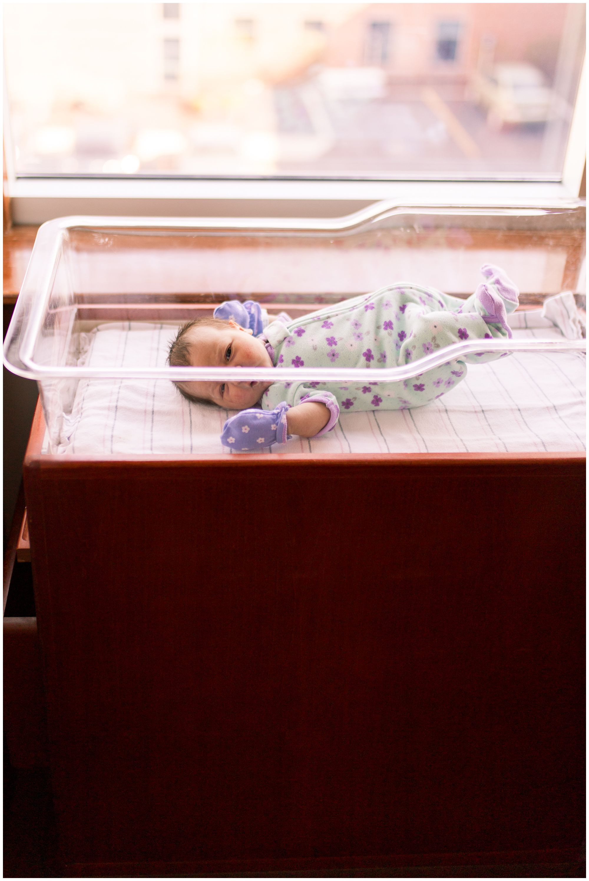 newborn in crib during Community Howard Regional Health newborn session in Kokomo Indiana