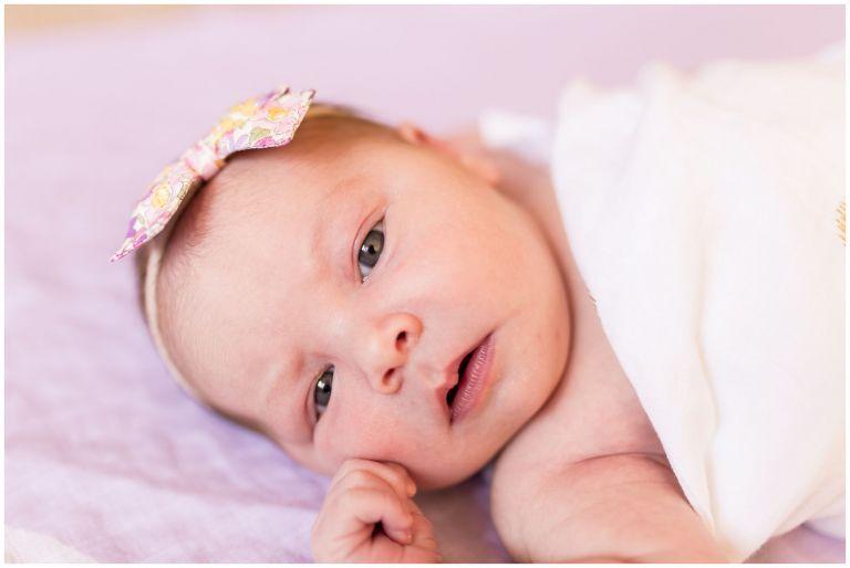 Westfield newborn photographer captures newborn with open eyes