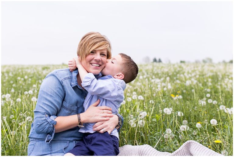mom and son in field of dandelions at Wildkat Creek Reservoir Park in Kokomo Indiana