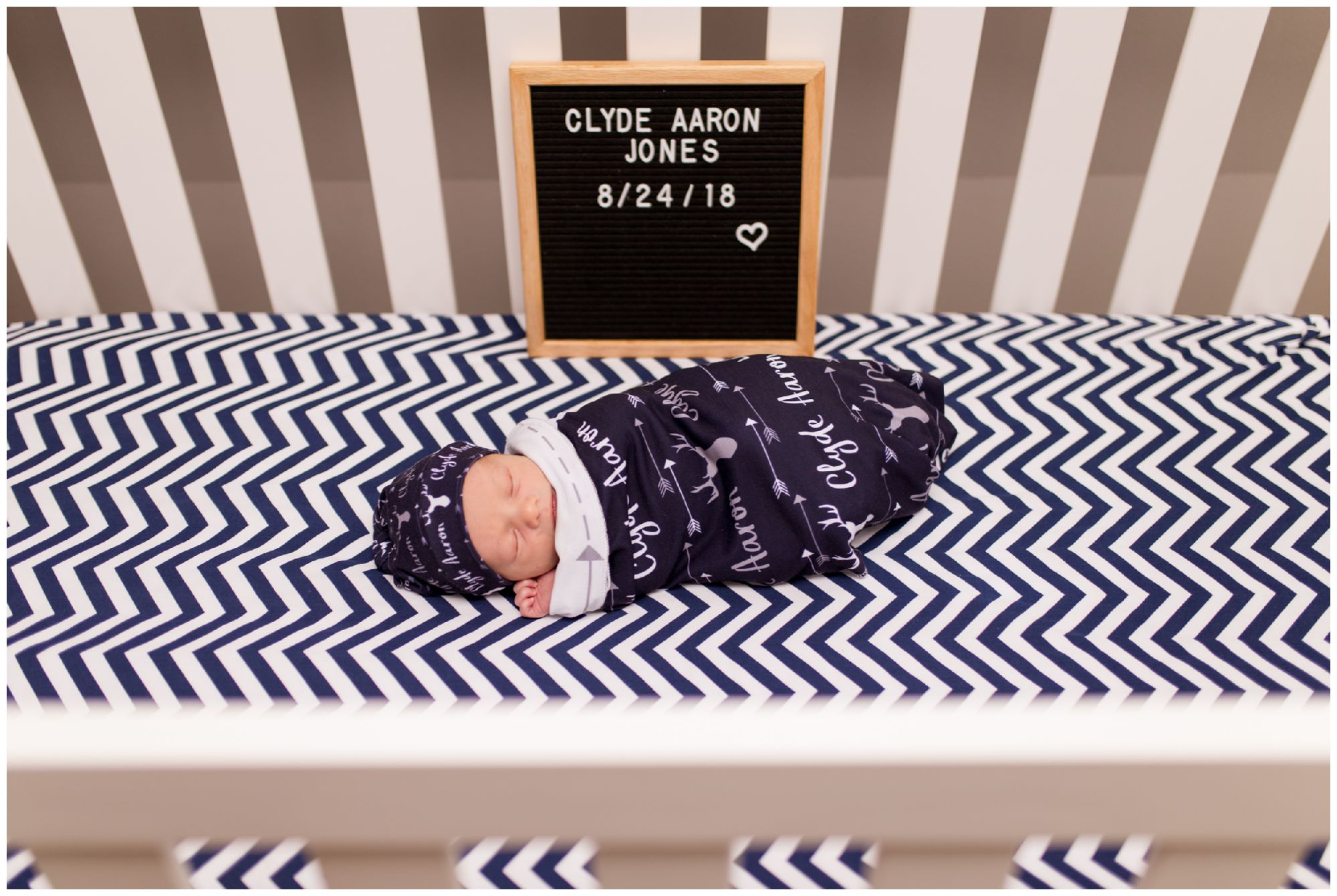 newborn with announcement sign during newborn session with Kokomo newborn photographer