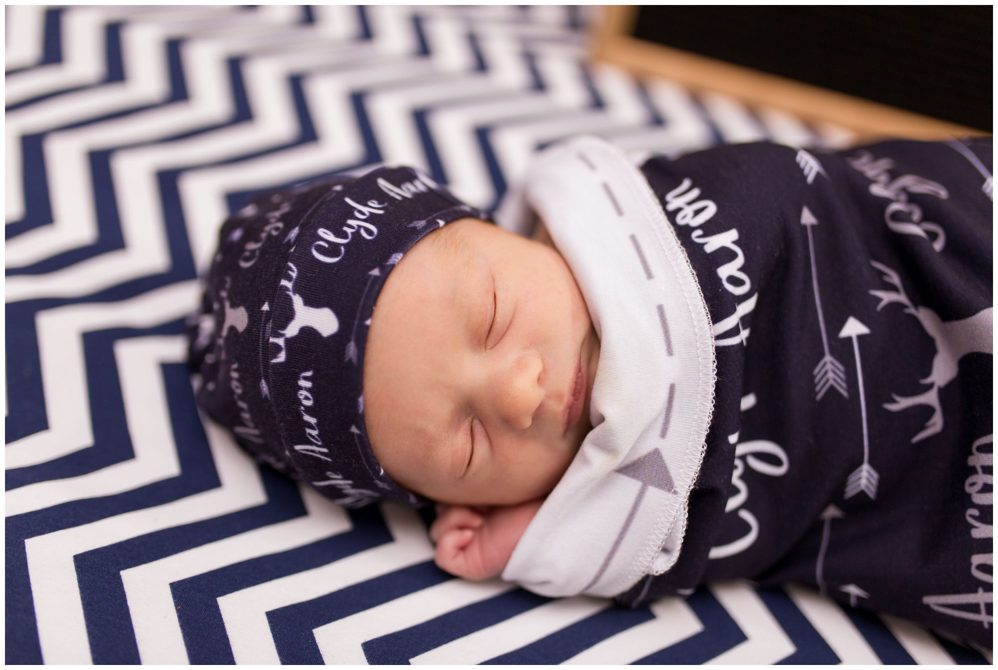 newborn in custom navy swaddle during Kokomo newborn session
