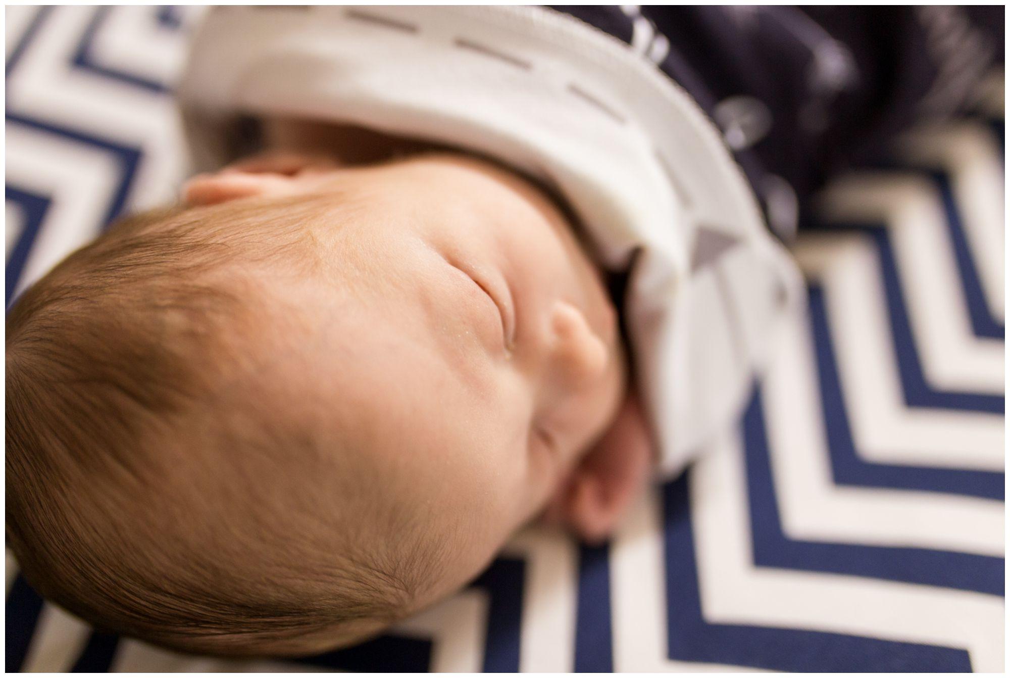 close up on newborn eyes and hair during Kokomo newborn session