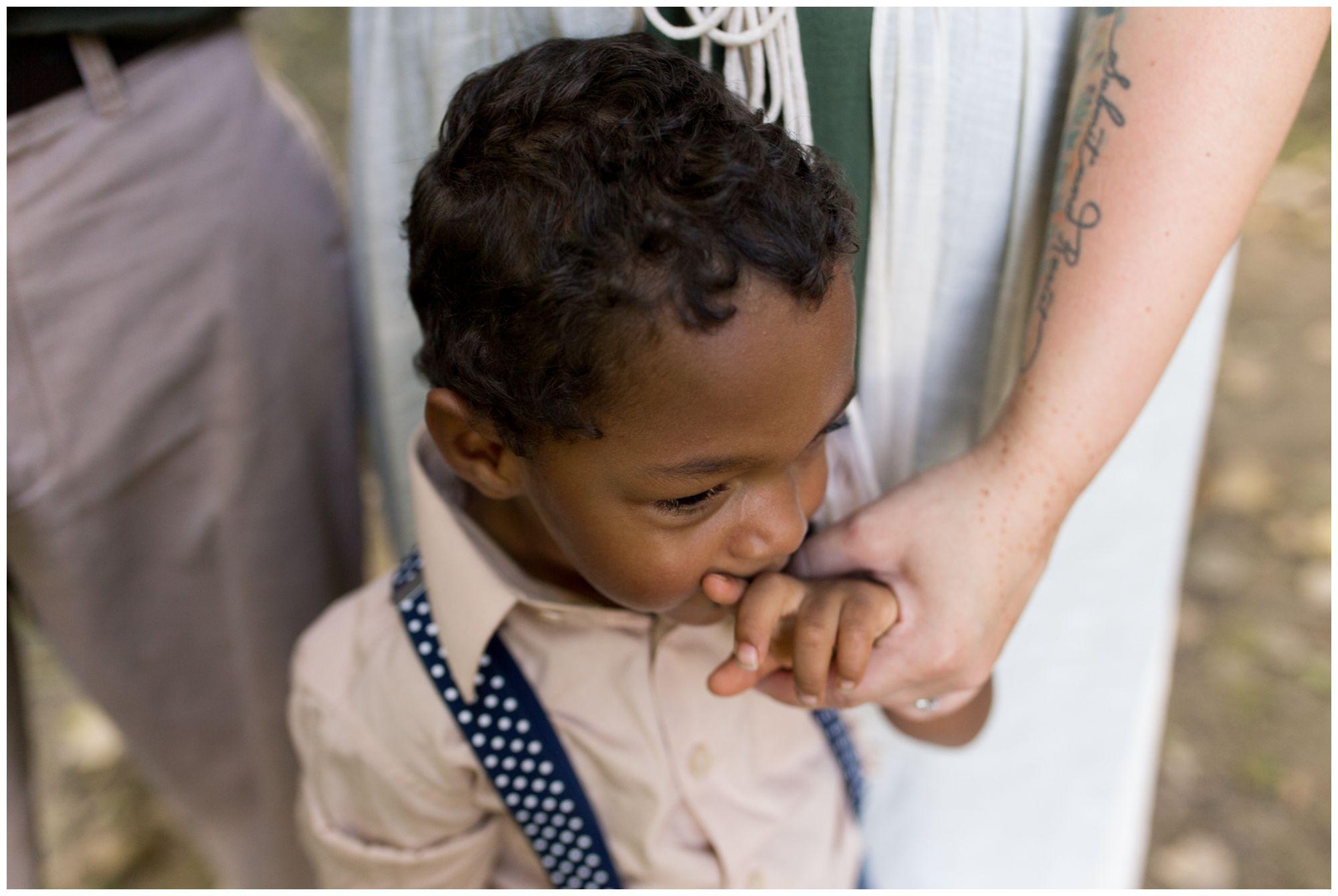 mom holding son's hand during Kokomo family session at Jackson Morrow Park