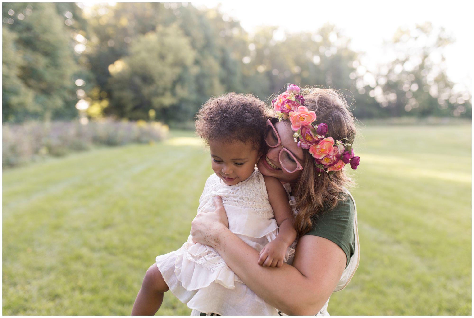 mom hugs daughter at Jackson Morrow Park during Kokomo family session