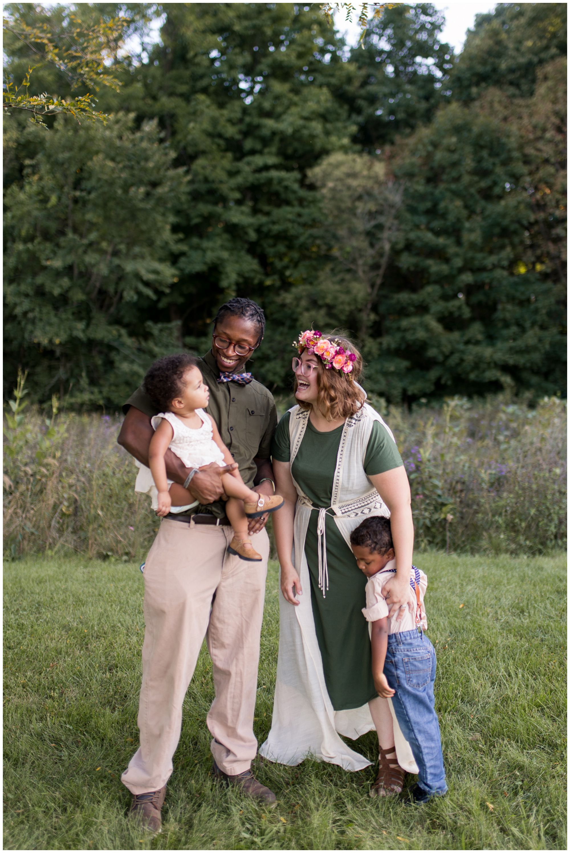 family looking at one another during Kokomo family session at Jackson Morrow Park