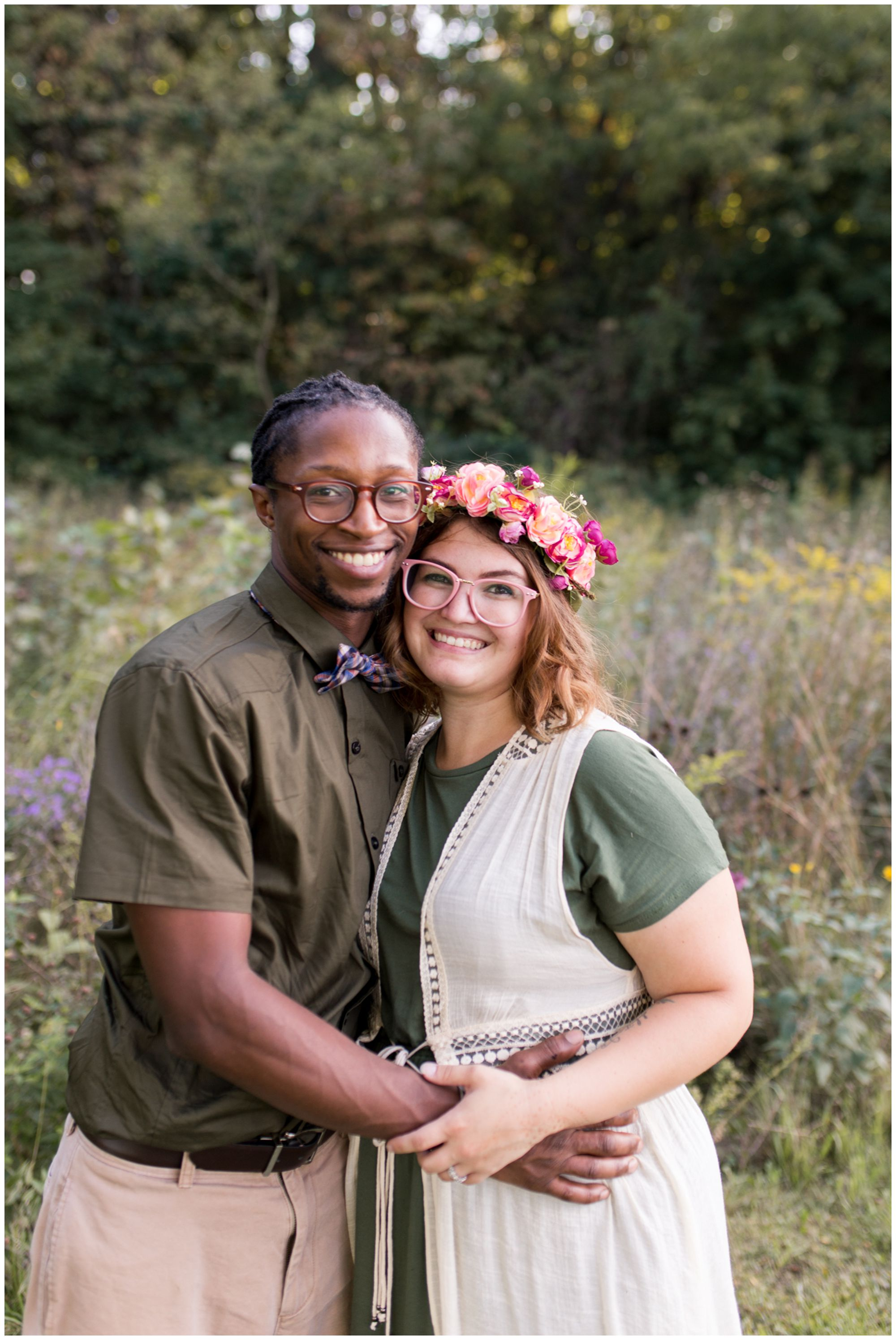 husband and wife hold one another during Kokomo family session at Jackson Morrow Park