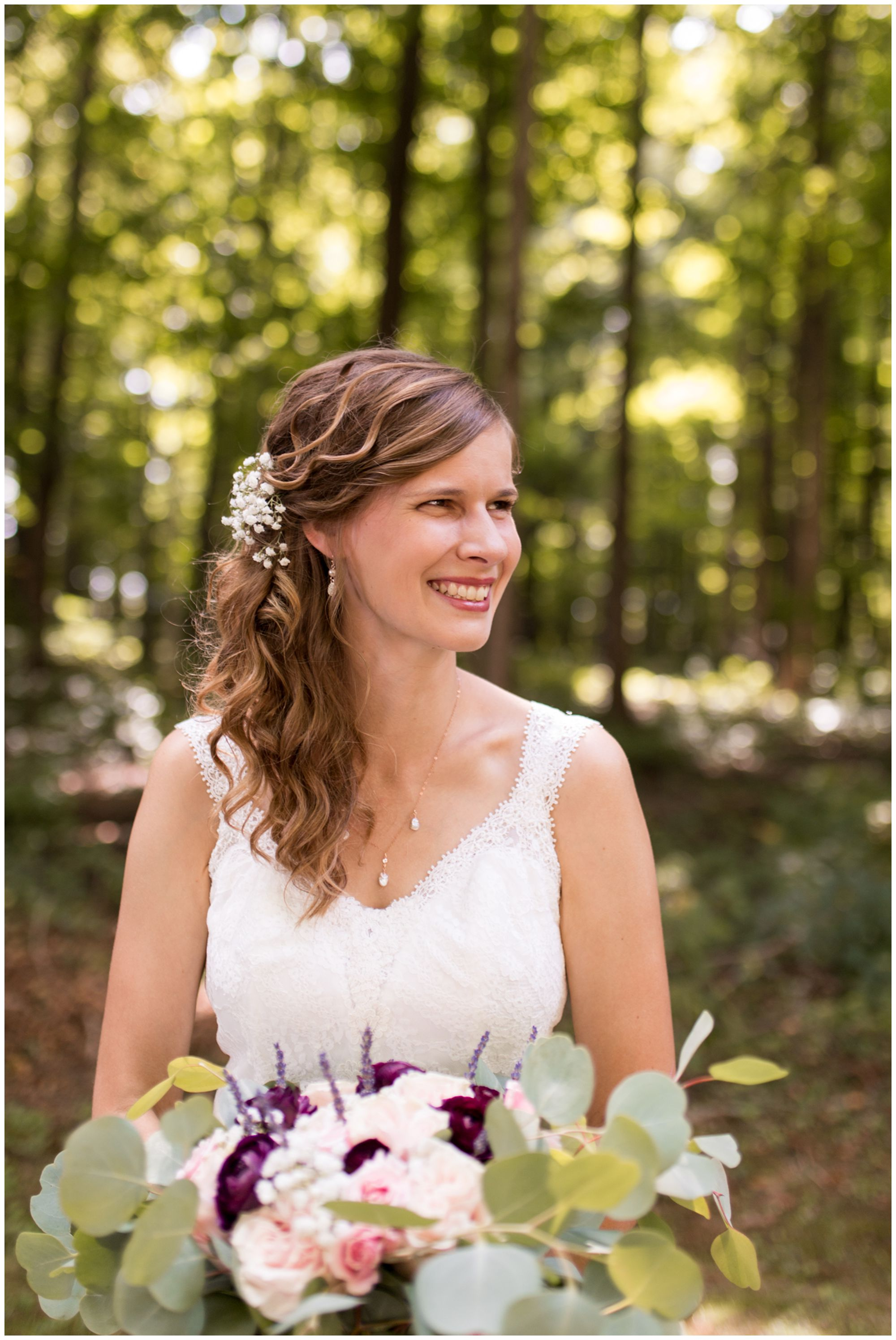 bride Tabea faces camera while holding bouquet and looking to left smiling