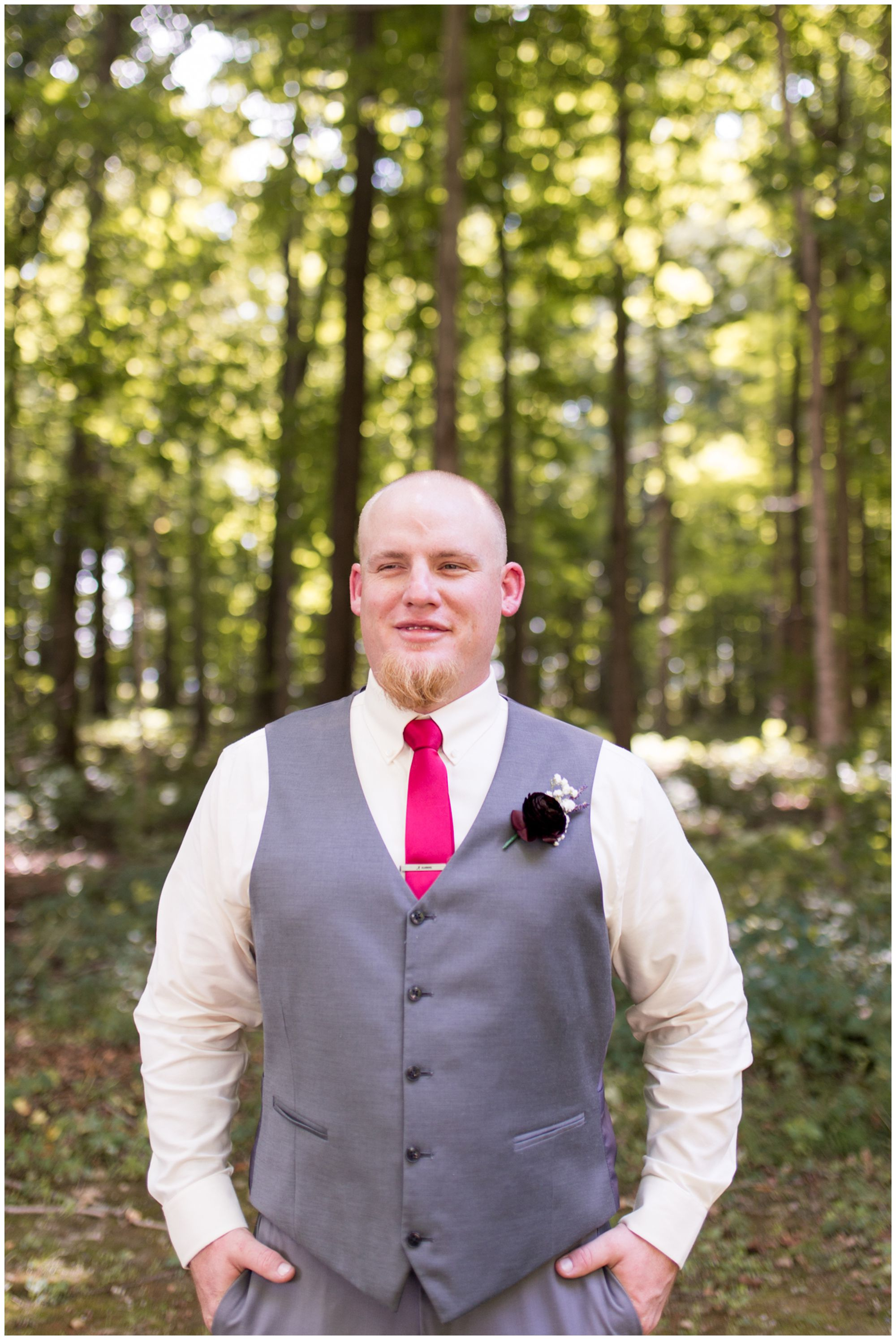 groom Daniel faces straight on toward the camera and smiles at Kokomo wedding photographer