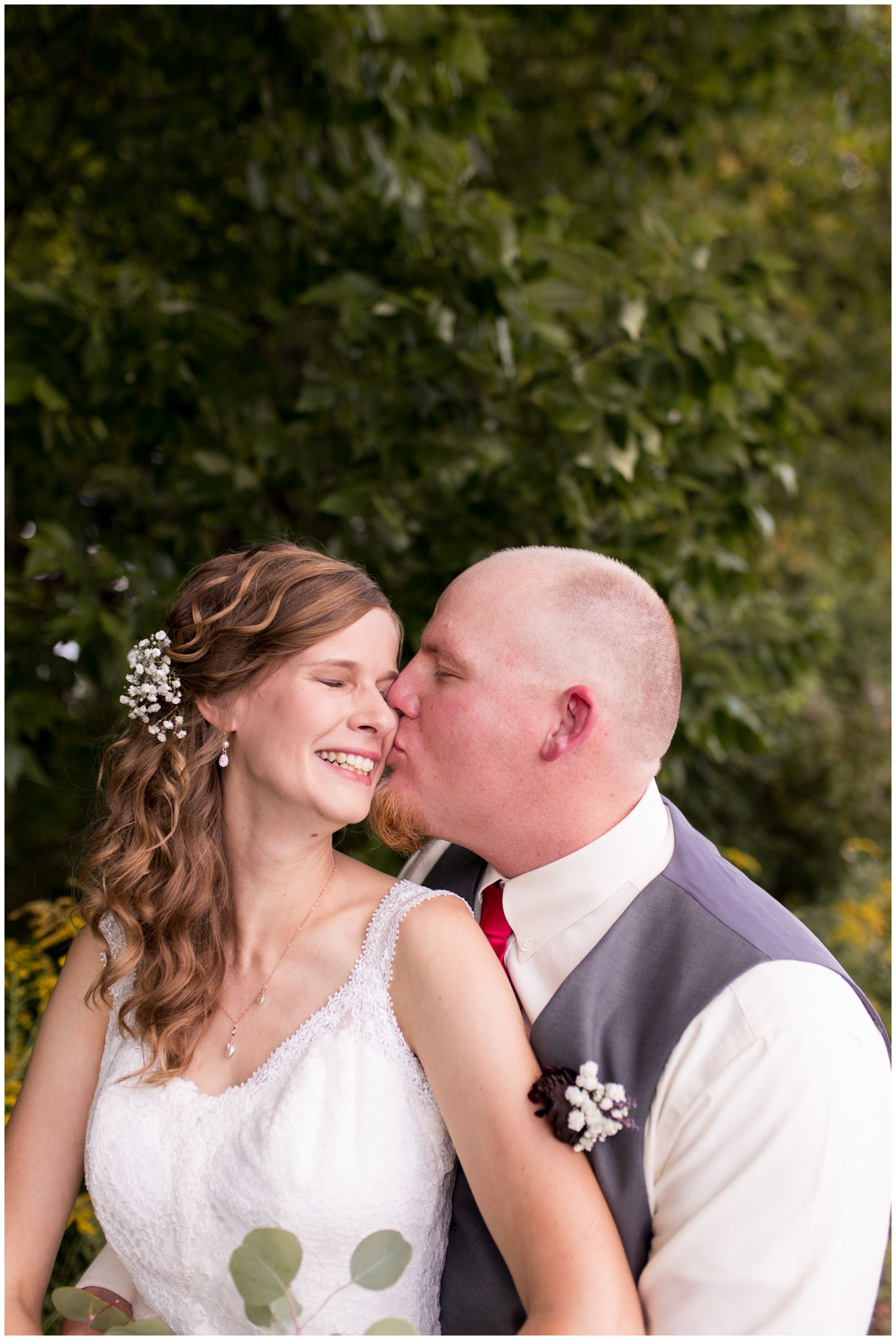 groom Daniel kisses bride Tabea's cheek during Kokomo Indiana wedding photography