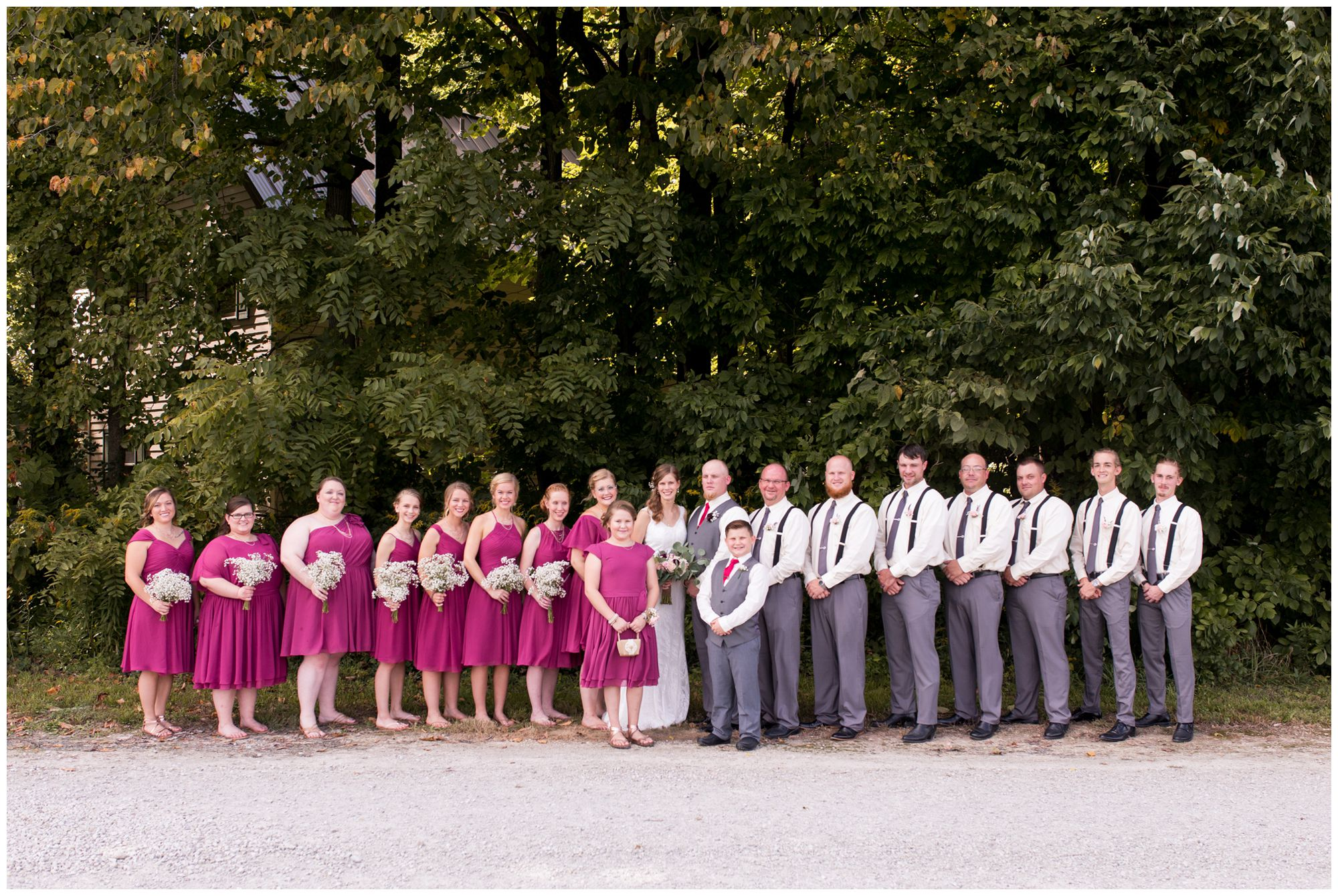 bride Tabea and groom Daniel with bridesmaids to left and groomsmen to left and flower girl and ring bearer in center of photo