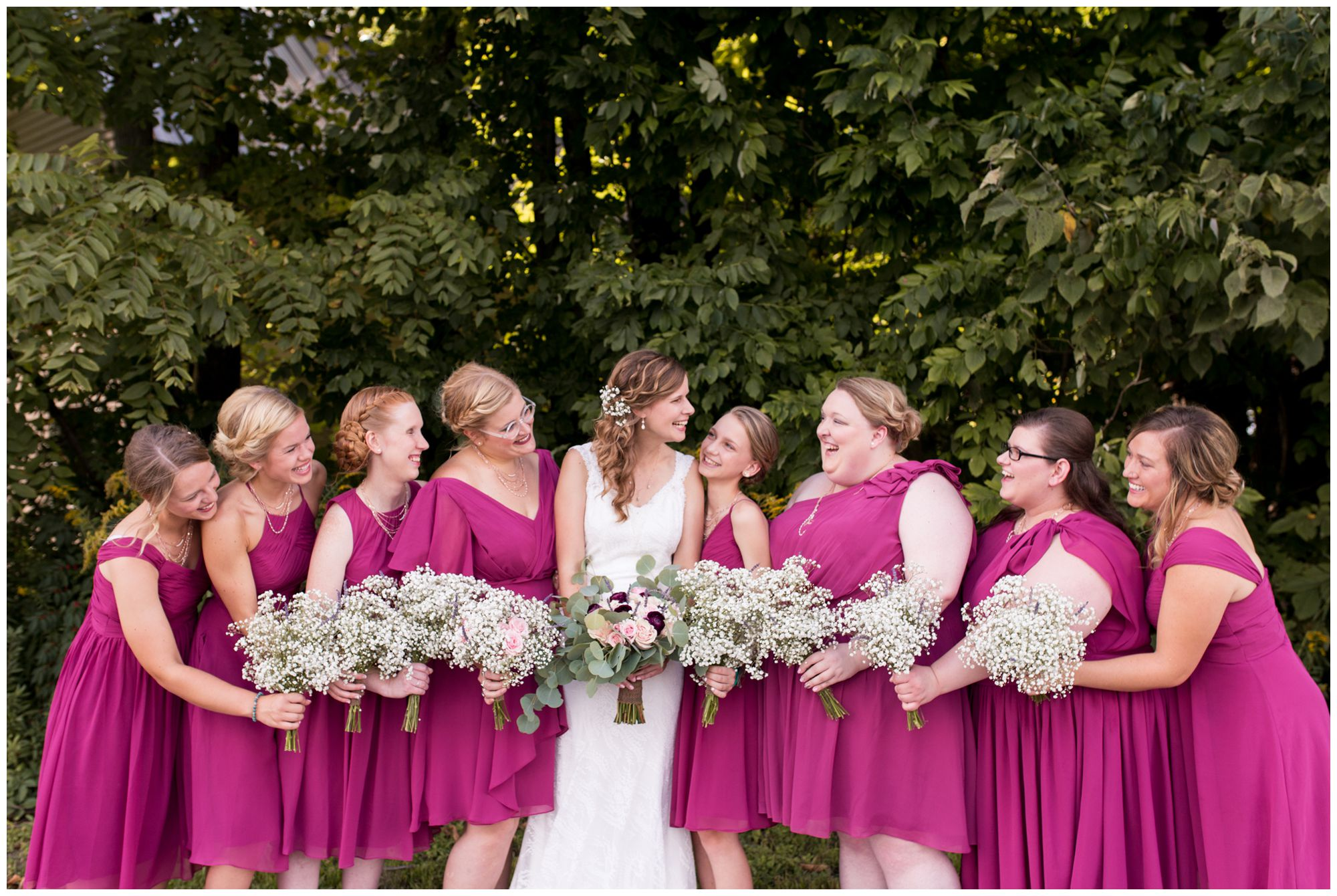 bride Tabea looks to her left with bridesmaids surrounding her at Crossroads Community Church