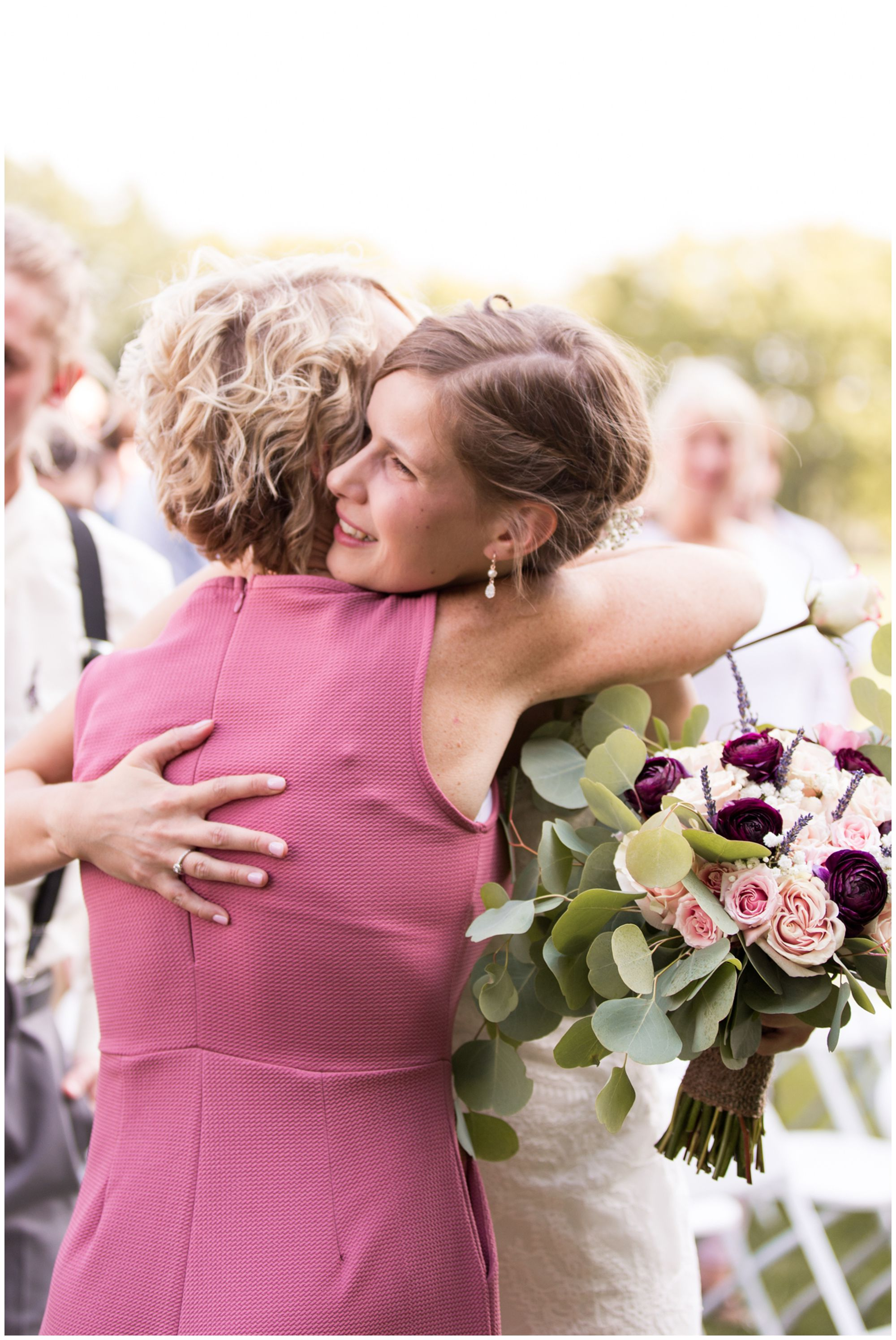 bride Tabea hugs mom Michelle after brothers give her away