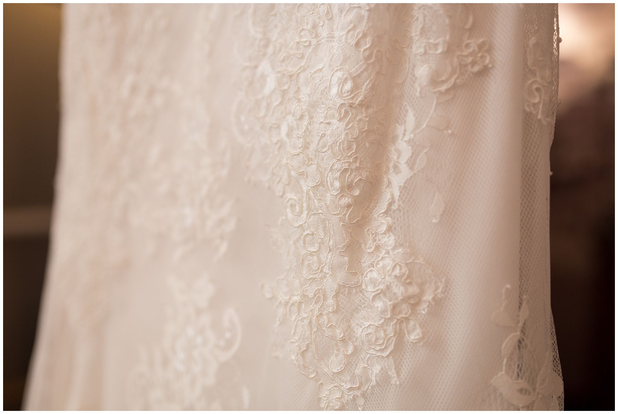 bride's lace detail on dress from Ellen's Bridal at Charley Creek Inn