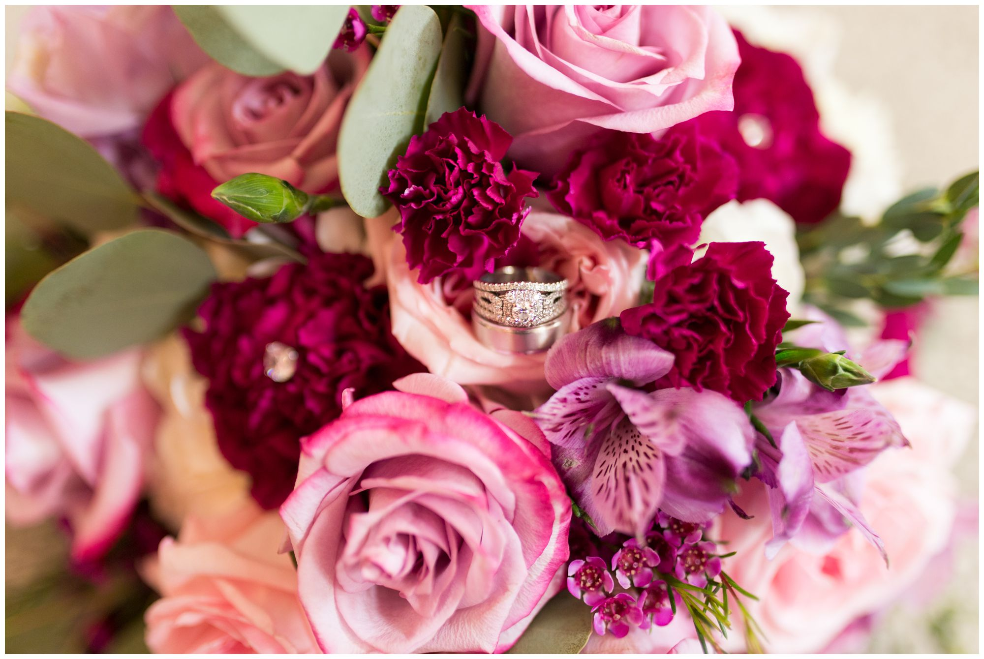 bride and groom's rings in floral bouquet at Wabash Indiana wedding