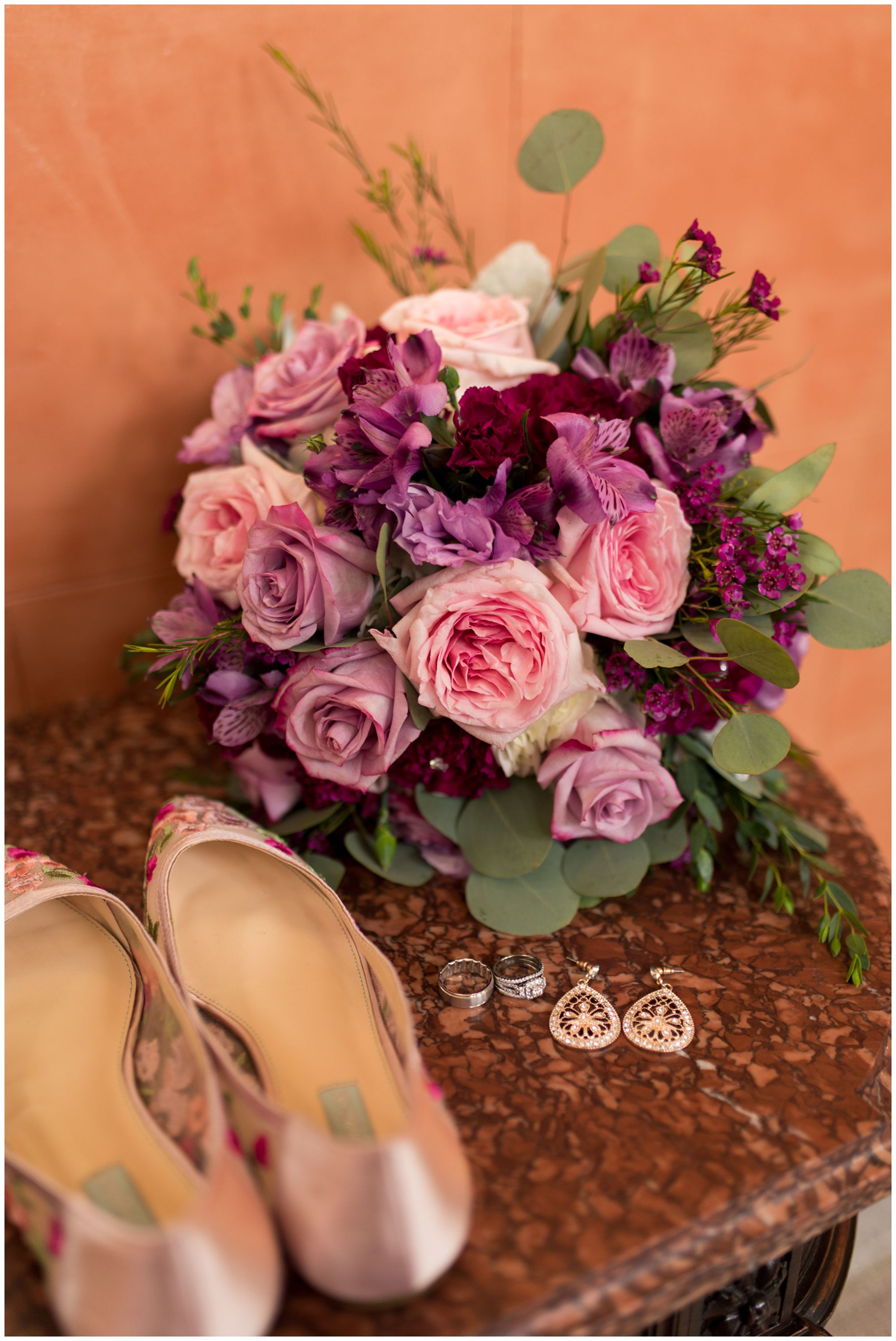 bride's bouquet, floral shoes, earrings and rings at Charley Creek Inn before Wabash Indiana wedding