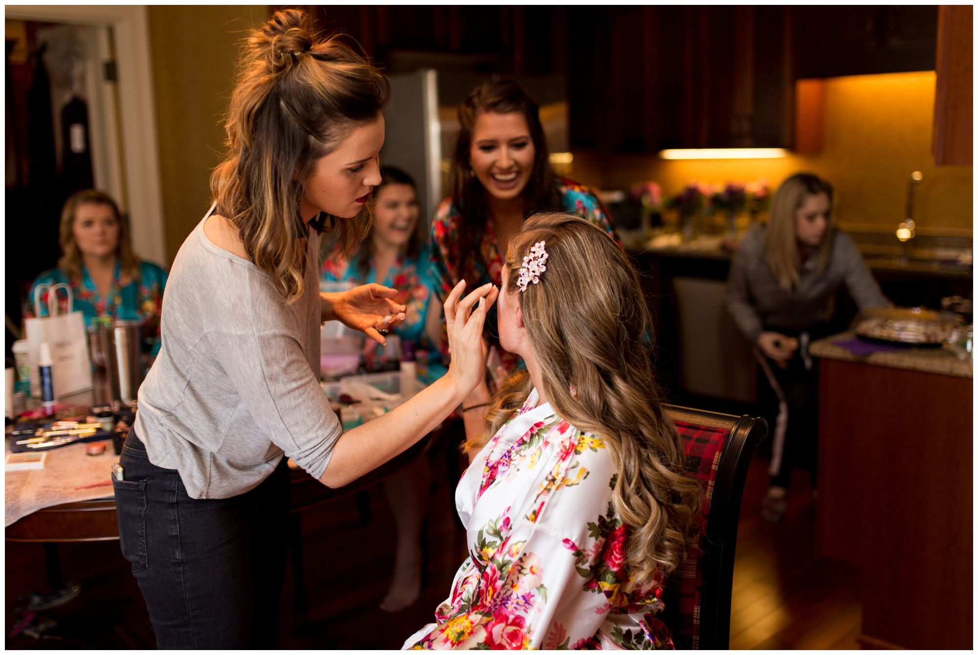 bride gets makeup done in hotel suite at Charley Creek Inn in Wabash Indiana