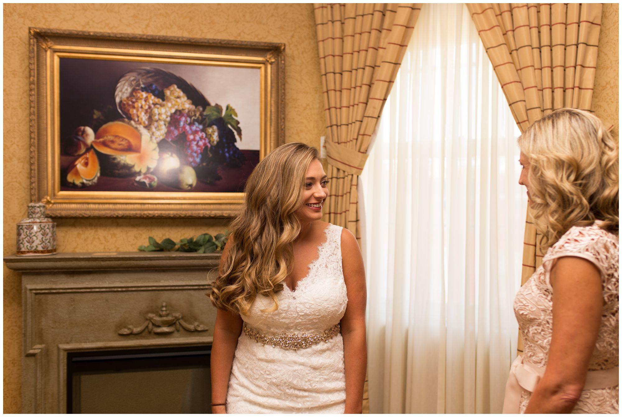 bride looks at mom before Wabash Indiana wedding at Charley Creek Inn