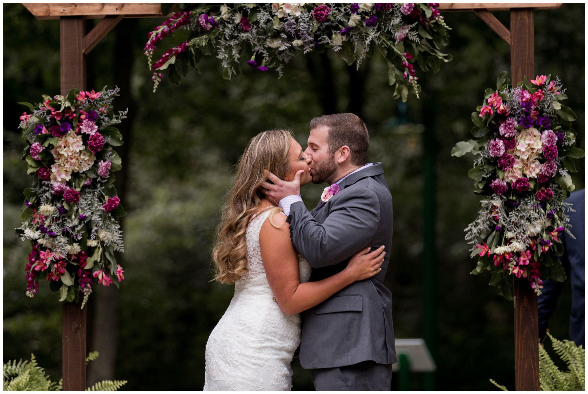 Wabash Indiana wedding ceremony at Charley Creek Gardens with bride and groom's first kiss