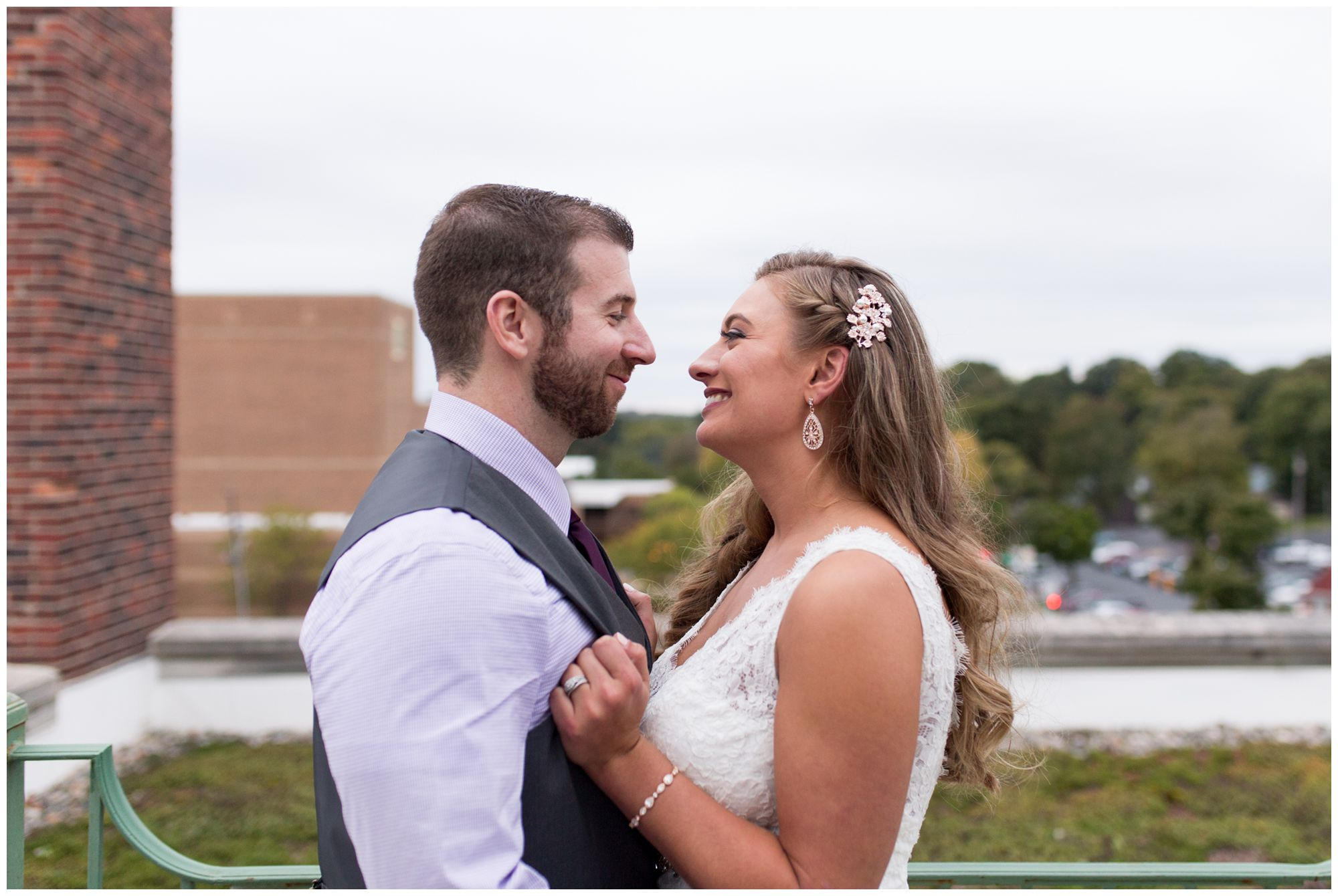 bride and groom portraits on Charley Creek Inn rooftop in downtown Wabash Indiana