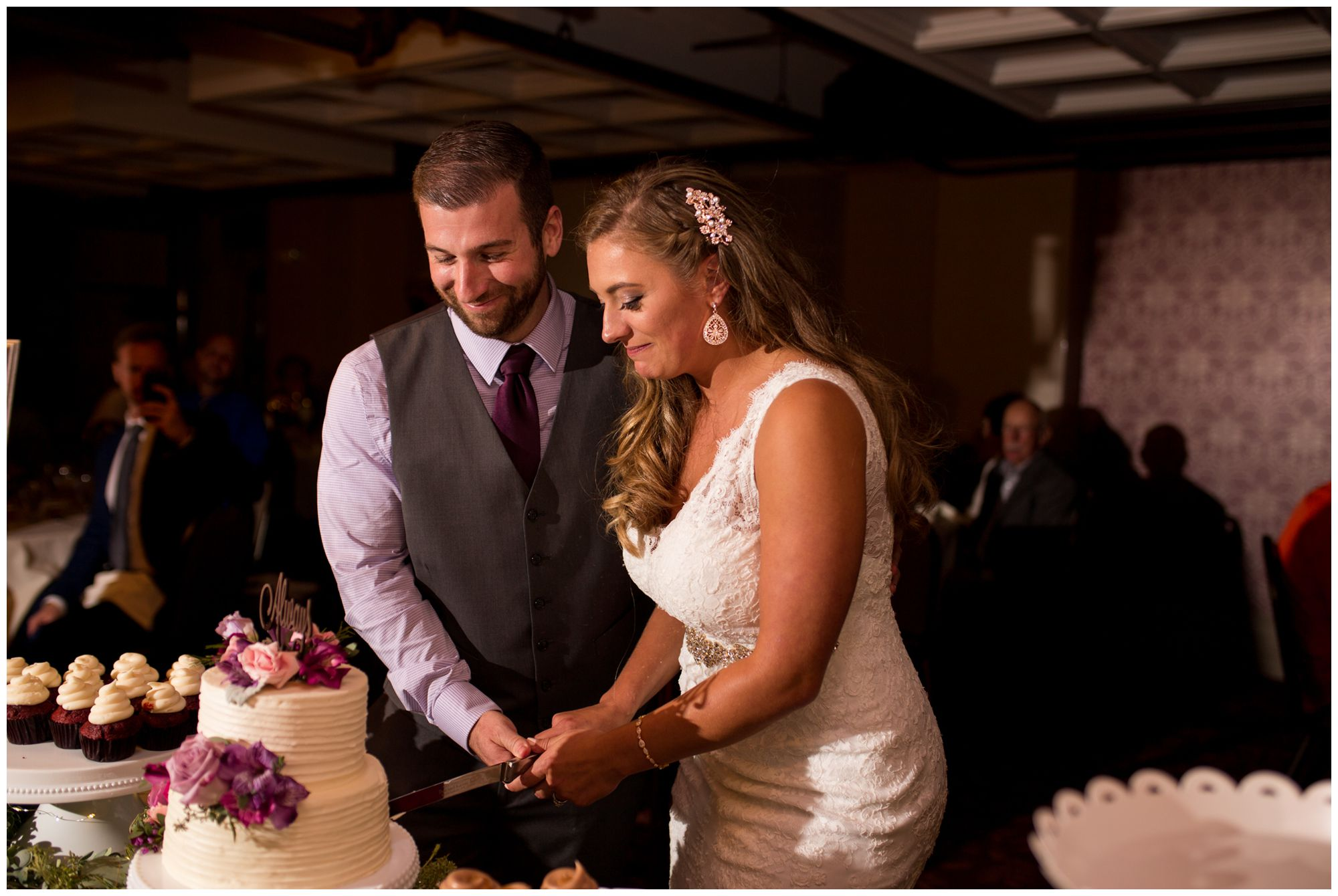 bride and groom cutting cake during Wabash Indiana wedding reception at Charley Creek Inn
