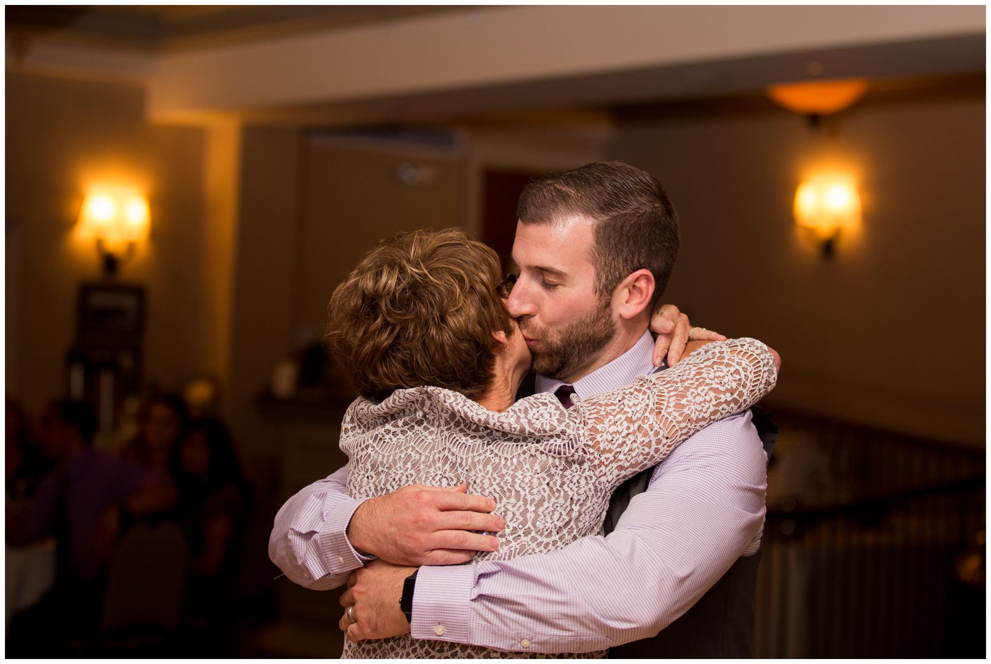 groom and mom share dance during Wabash Indiana wedding reception at Charley Creek Inn