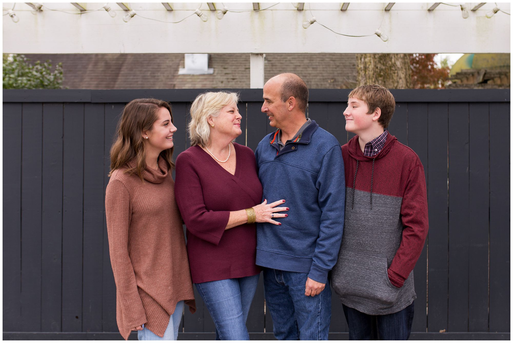 family session in downtown Zionsville with family laughing