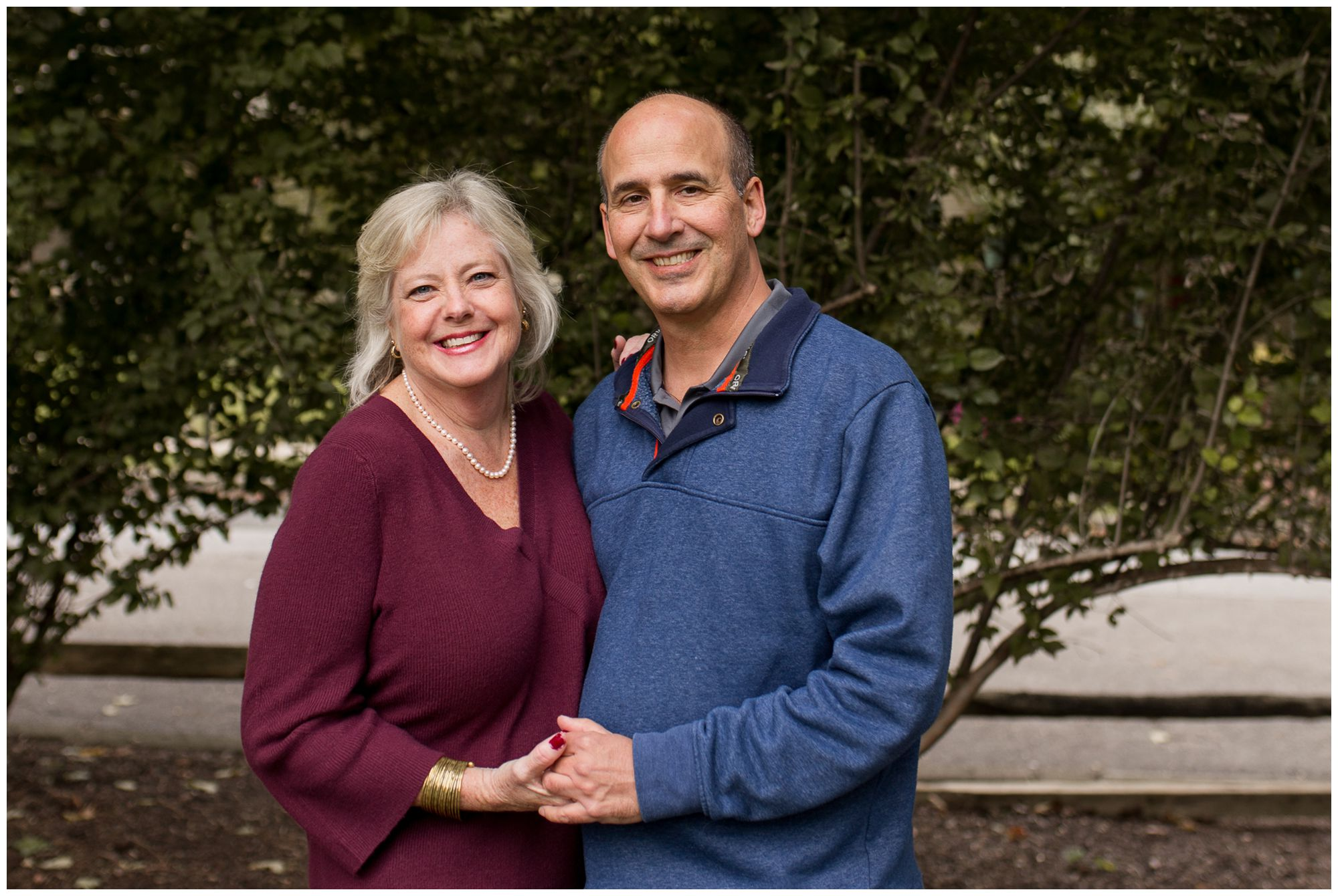 mom and dad together during family session in downtown Zionsville