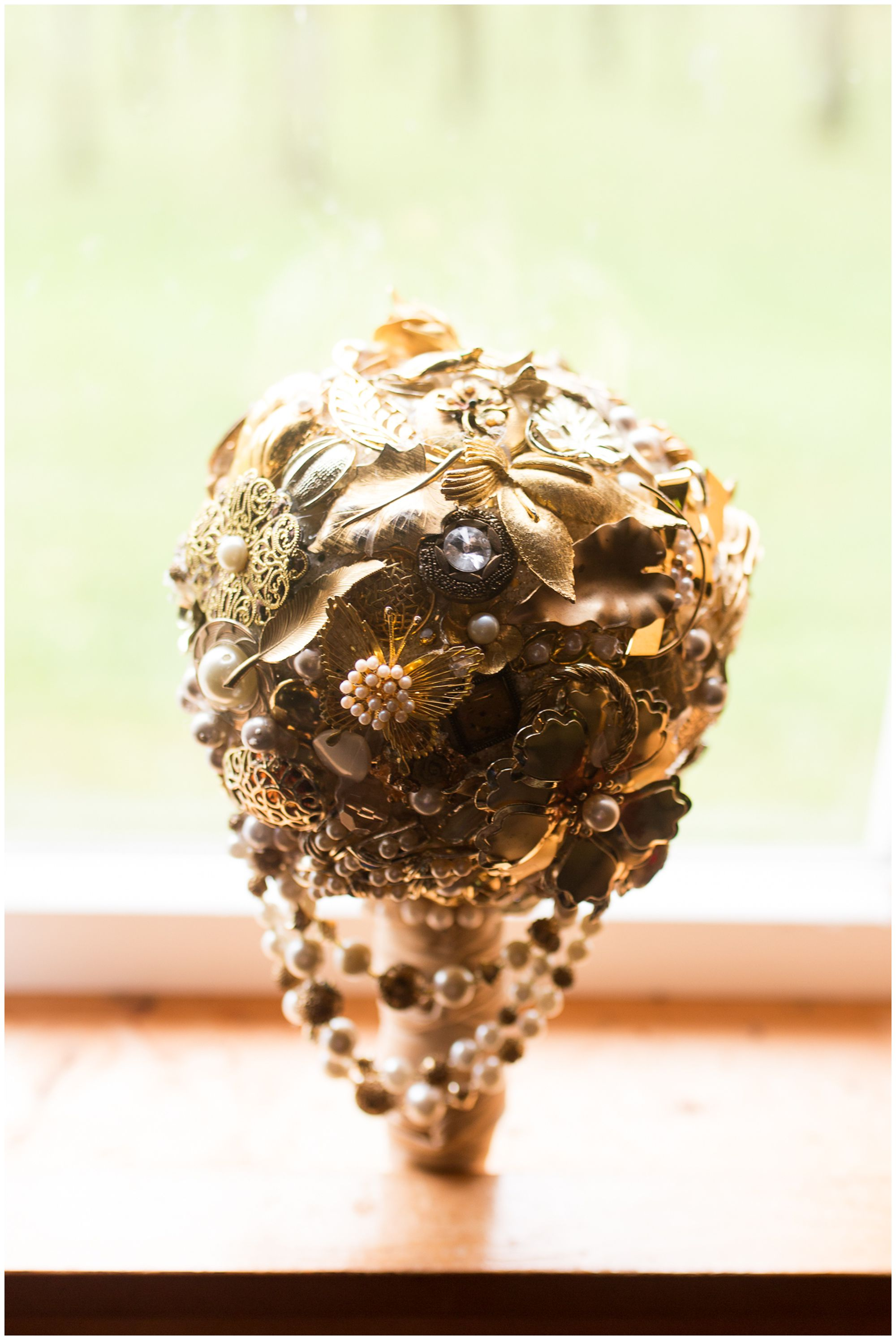 bride's bouquet made of gold broaches for Peru Indiana wedding
