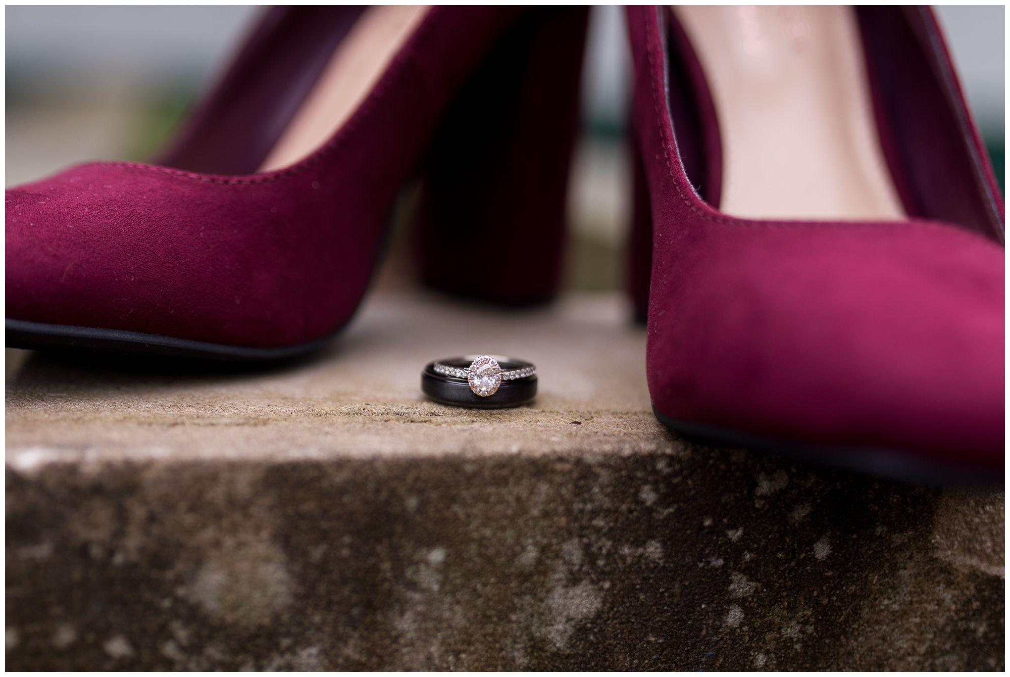 bride and groom rings between burgundy bride dress shoes at Peru Indiana wedding