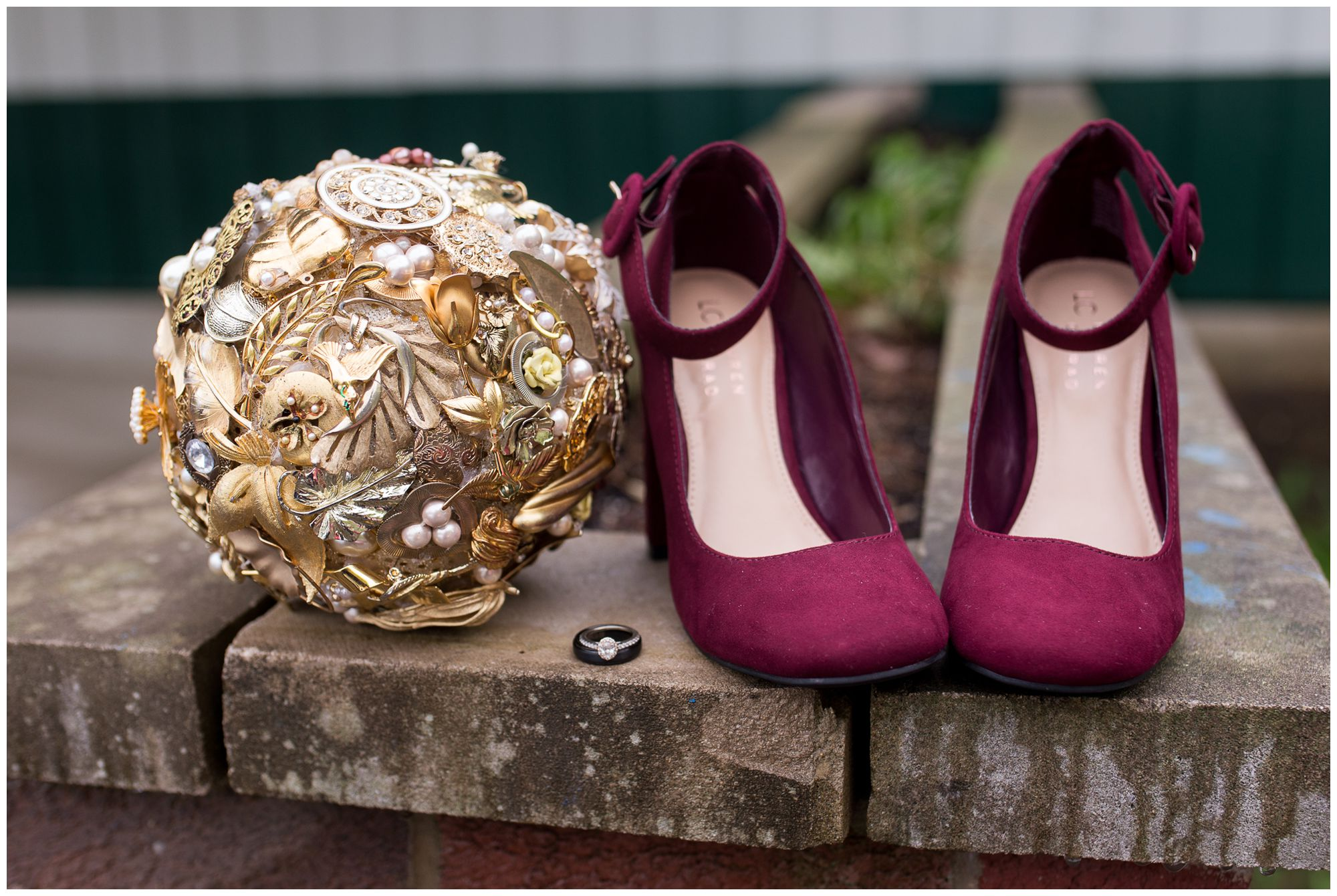 bride and groom rings between burgundy bride dress shoes and broach bouquet at Peru Indiana wedding