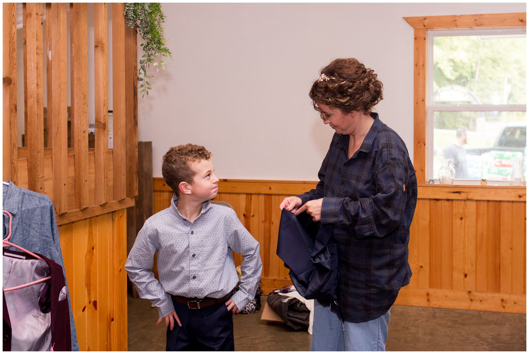 bride helps son get dressed for wedding day in Peru Indiana
