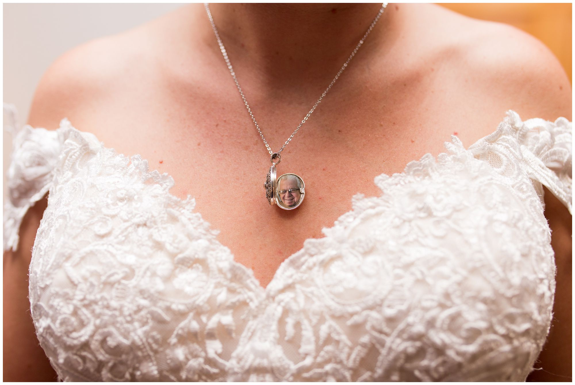 bride's locket with father's photo inside before Peru Indiana wedding