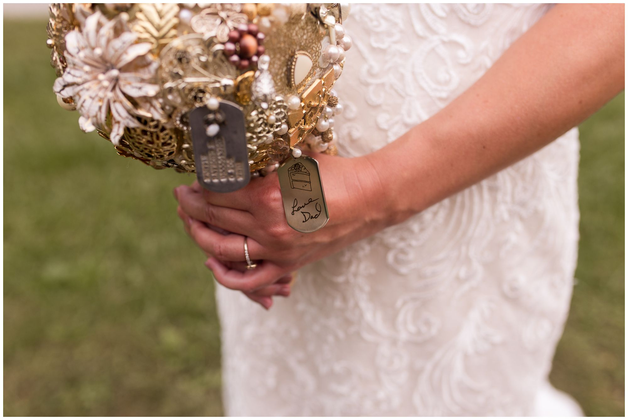 bride holds broach bouquet during wedding portraits in Peru Indiana