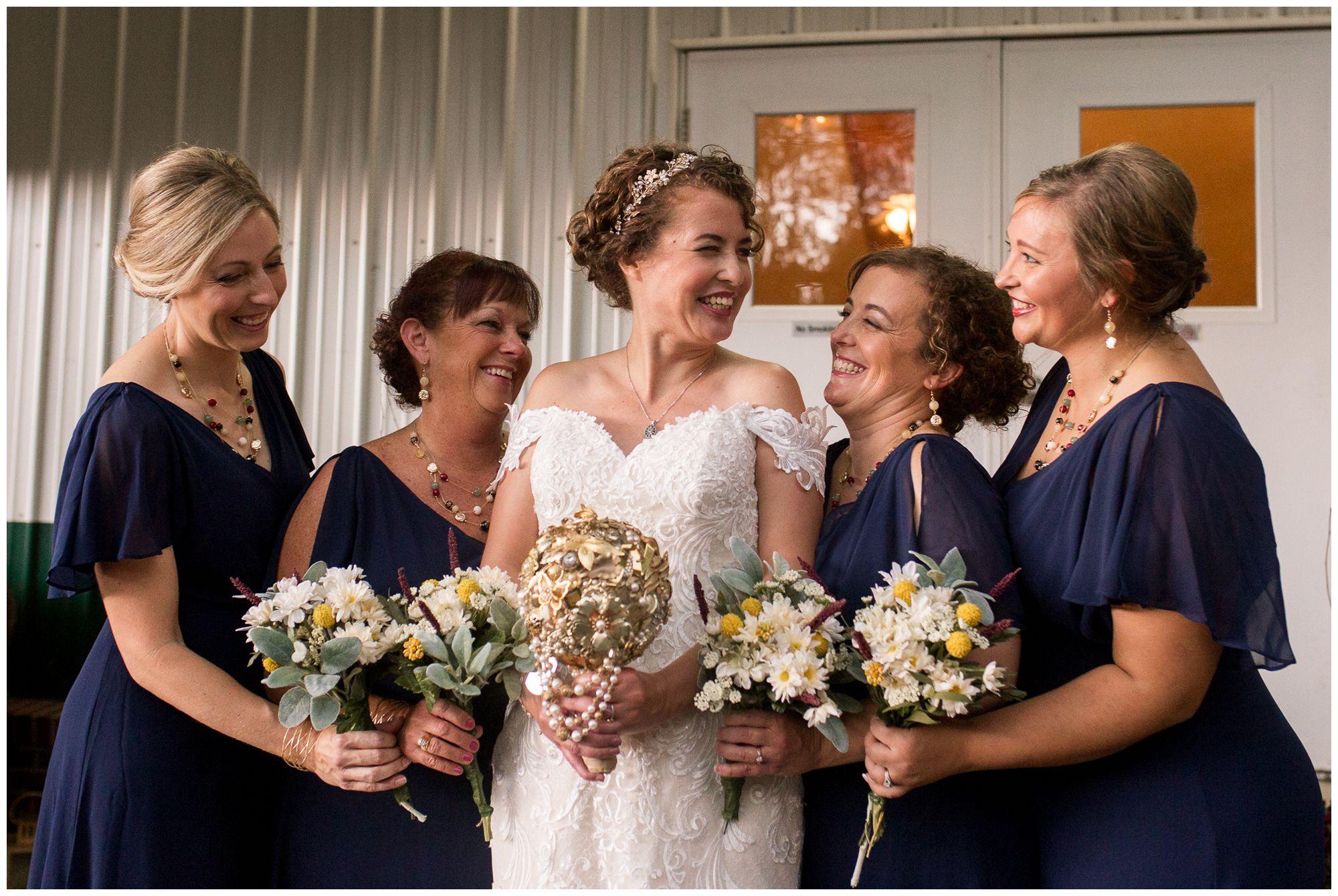 bride and bridesmaids laugh together before Peru Indiana wedding