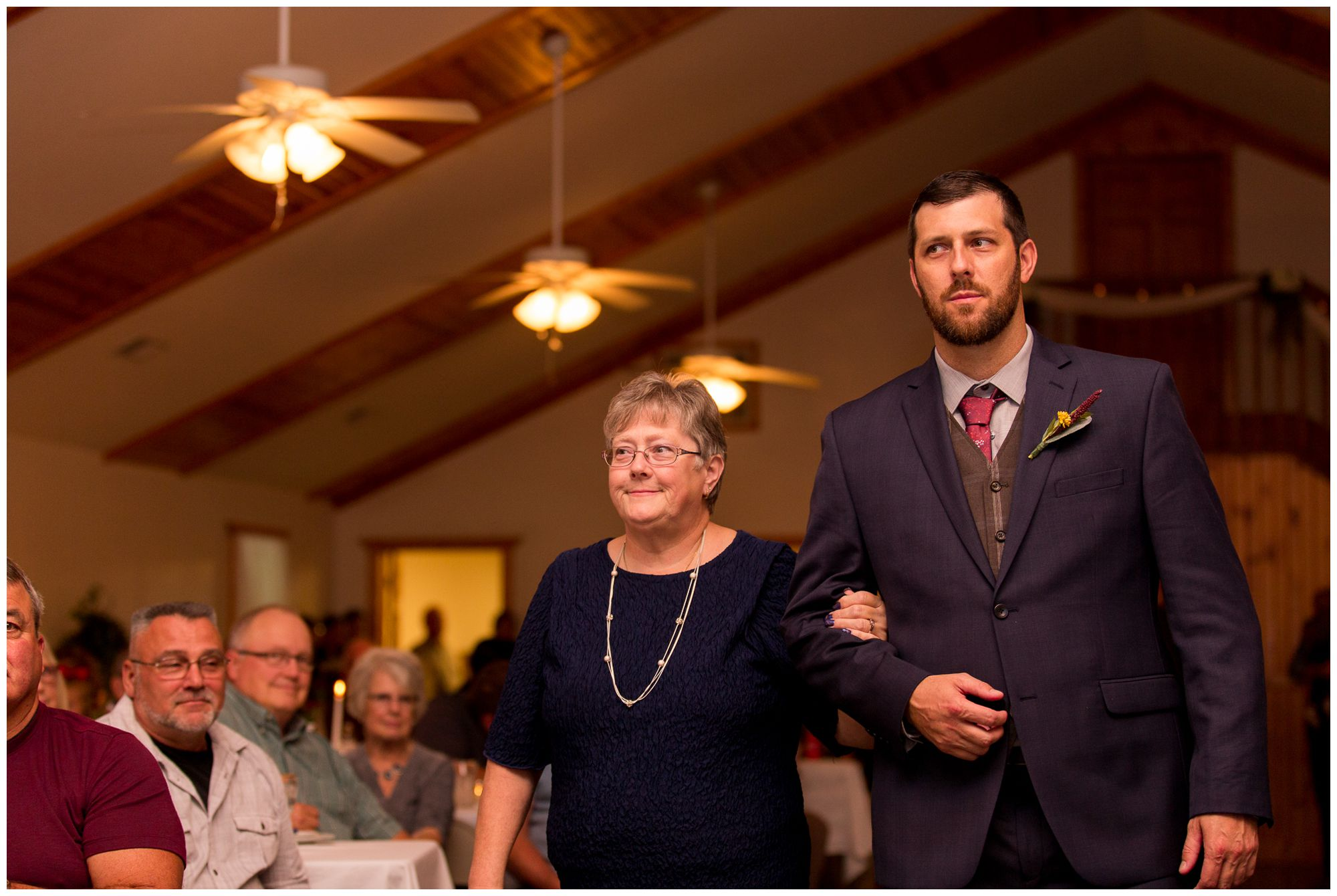 groom walking mother down the aisle before wedding ceremony in Peru Indiana