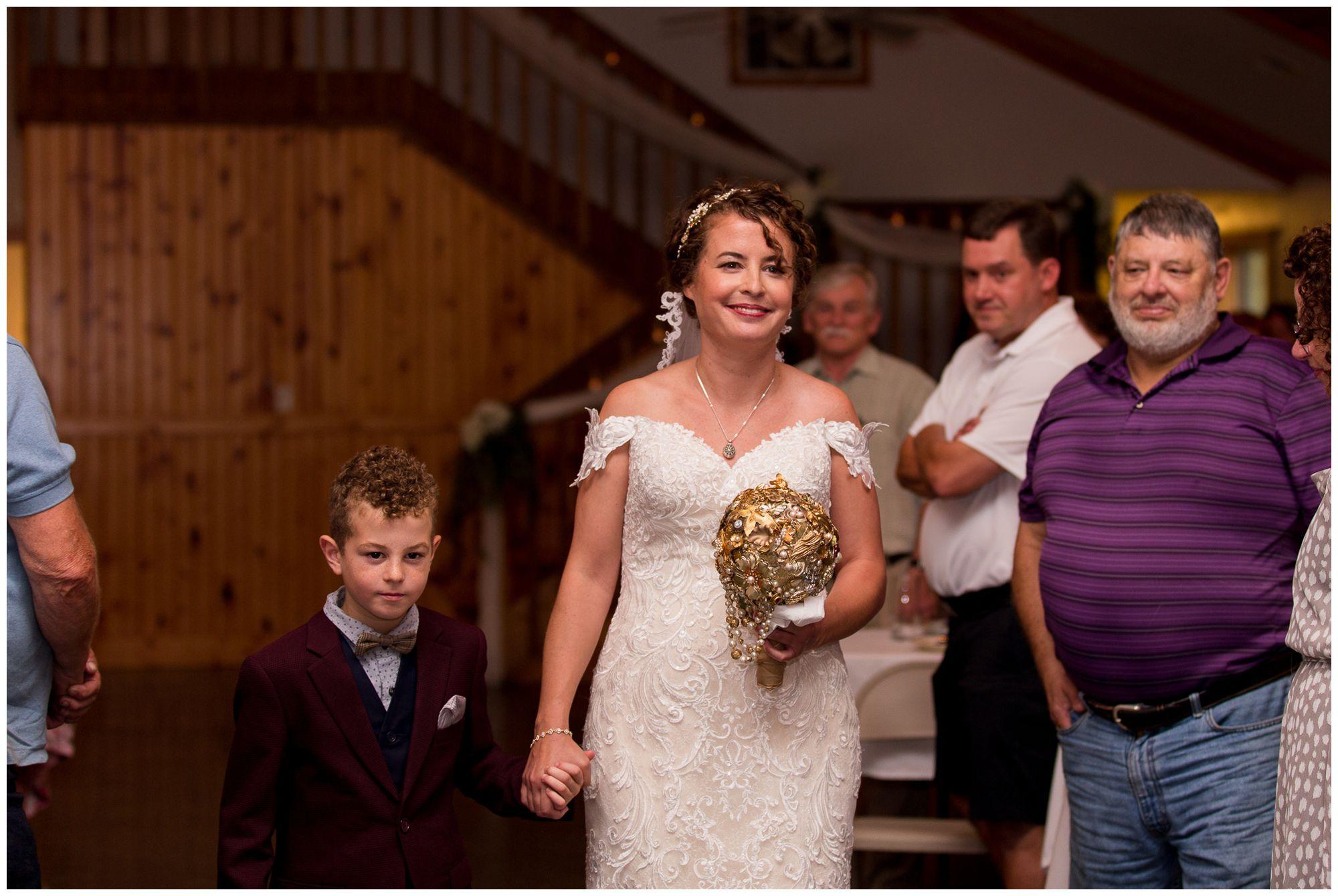 son walks bride down the aisle