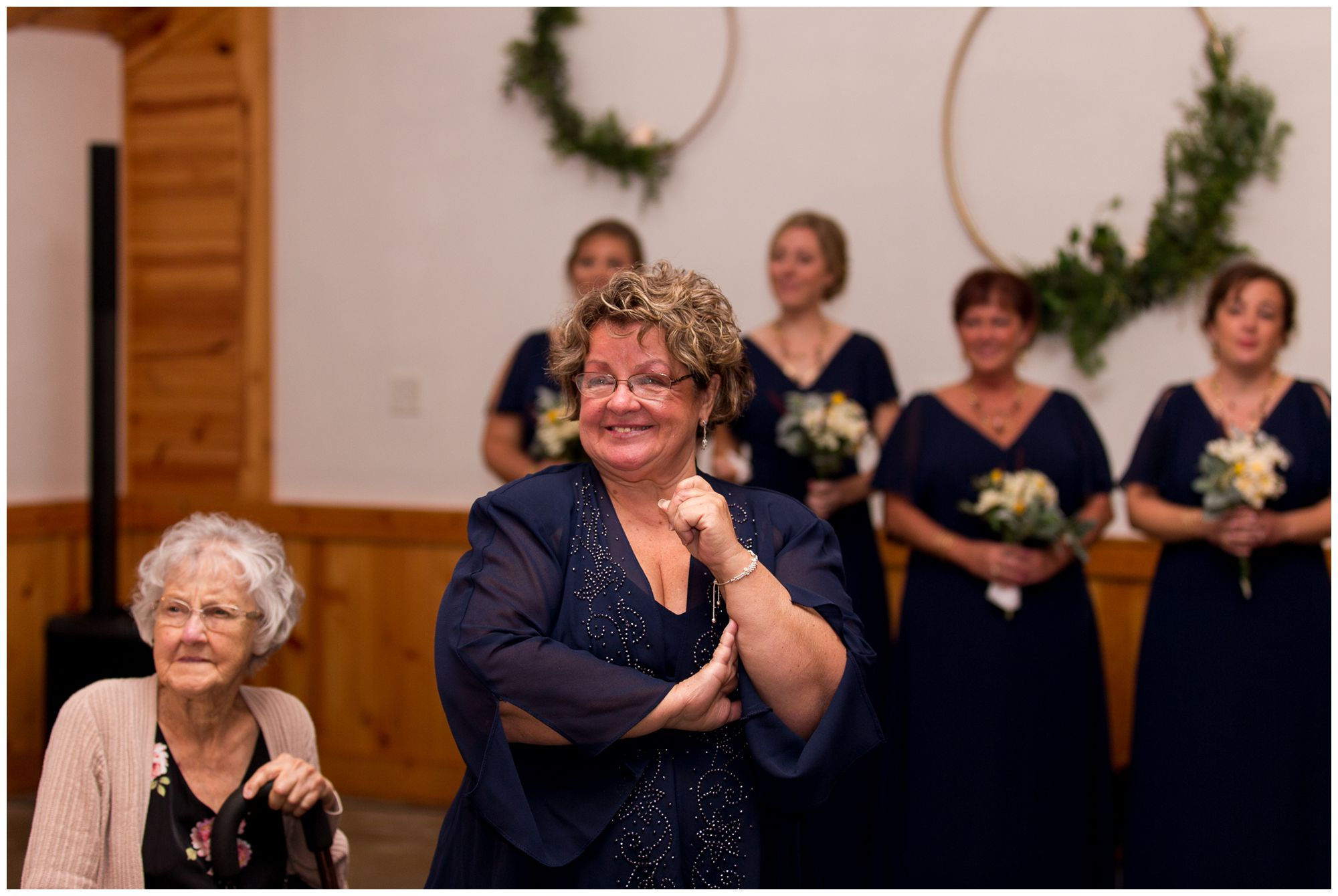 mother of bride cries as bride walks down aisle during Peru Indiana wedding