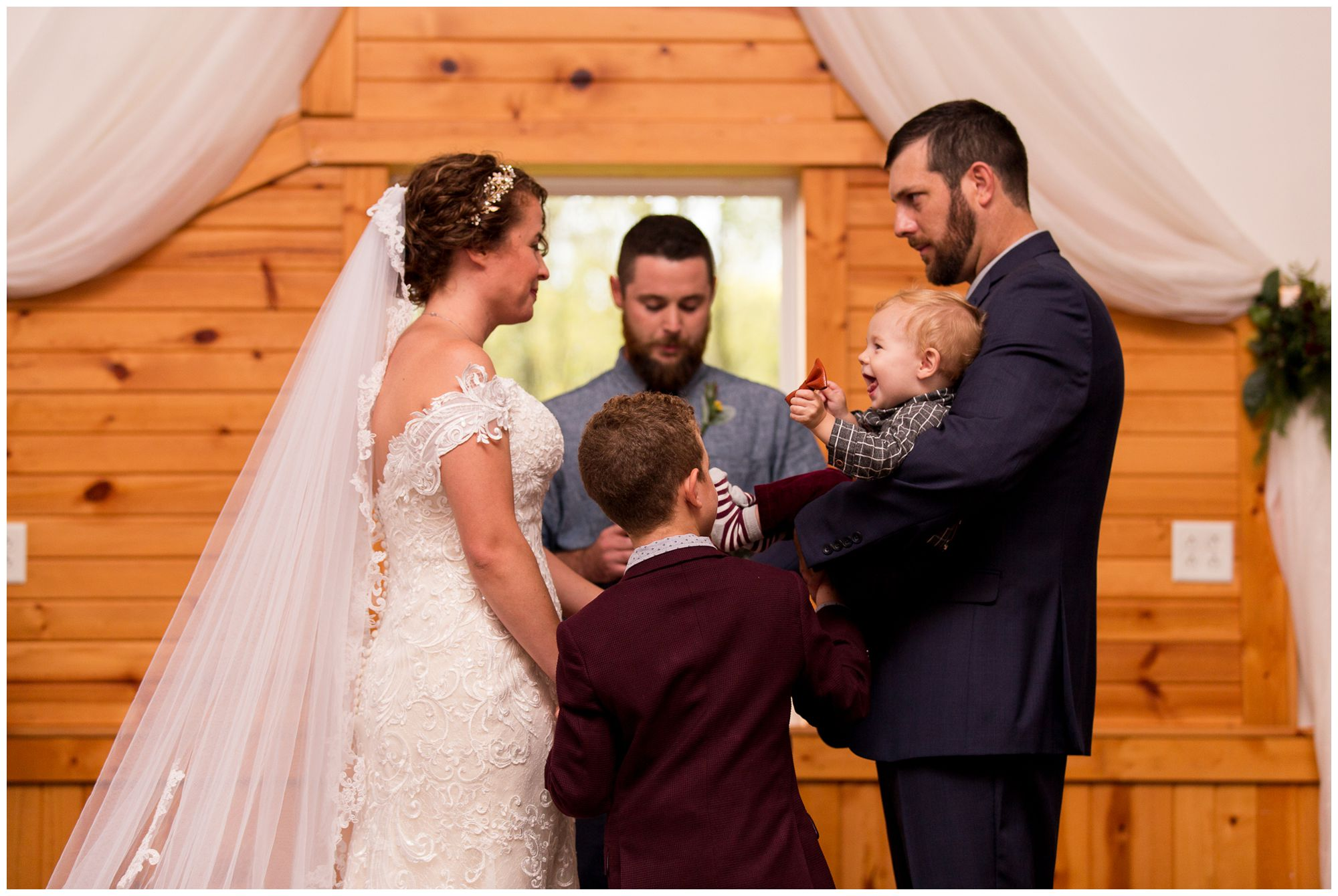 bride and groom making family commitment during Peru Indiana wedding ceremony