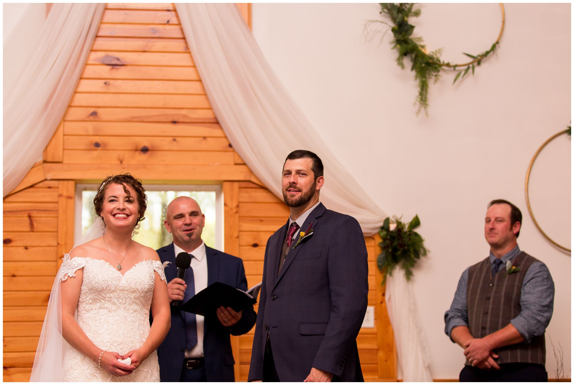 bride and groom look out at guests during Peru Indiana wedding ceremony