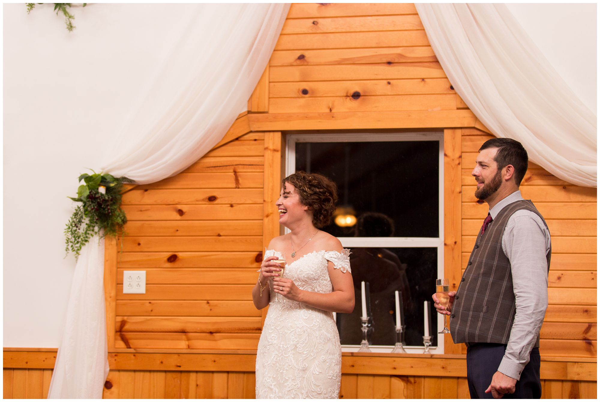 bride and groom laughing during Peru Indiana wedding reception toasts