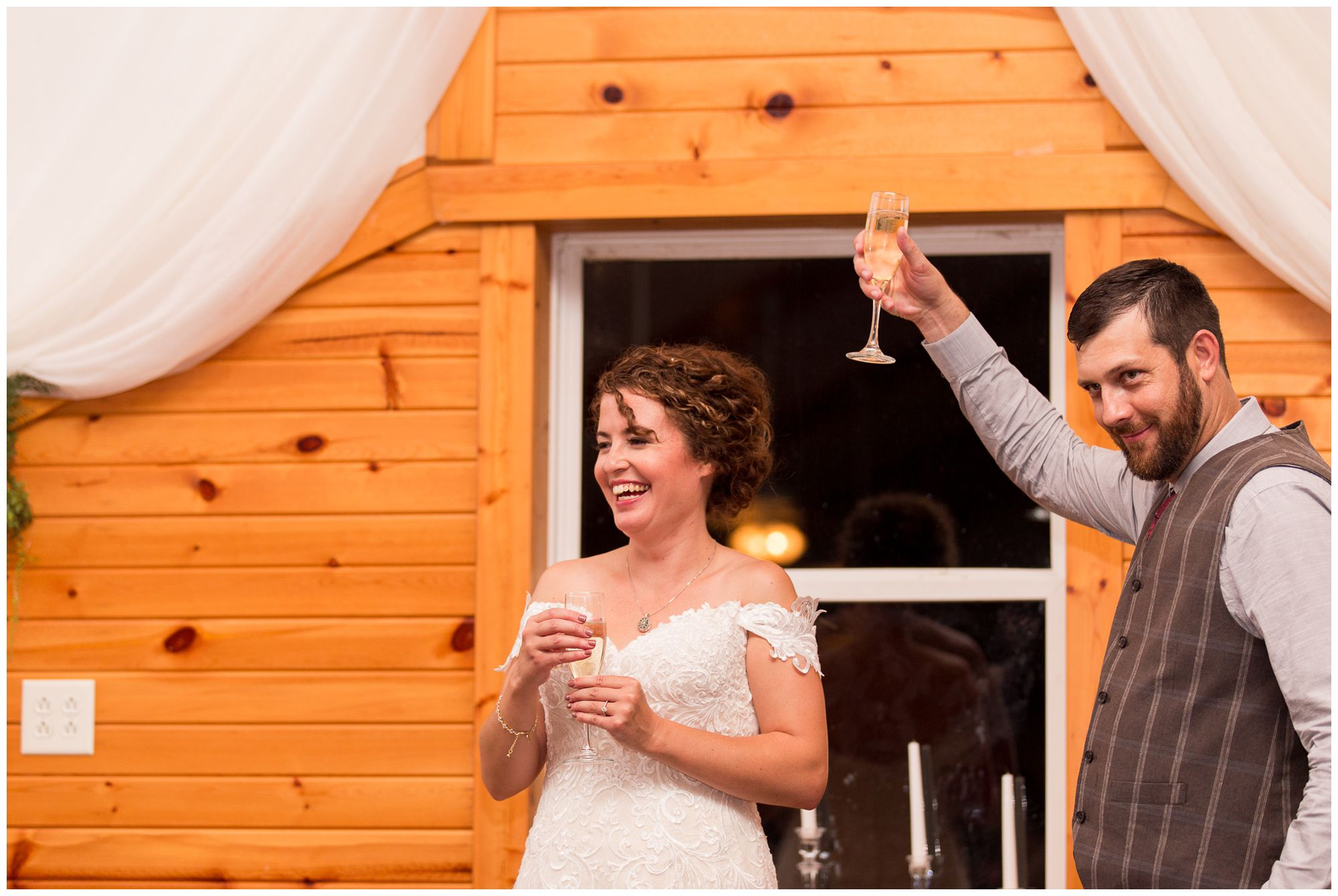groom lifts glass during toasts at Peru Indiana wedding reception