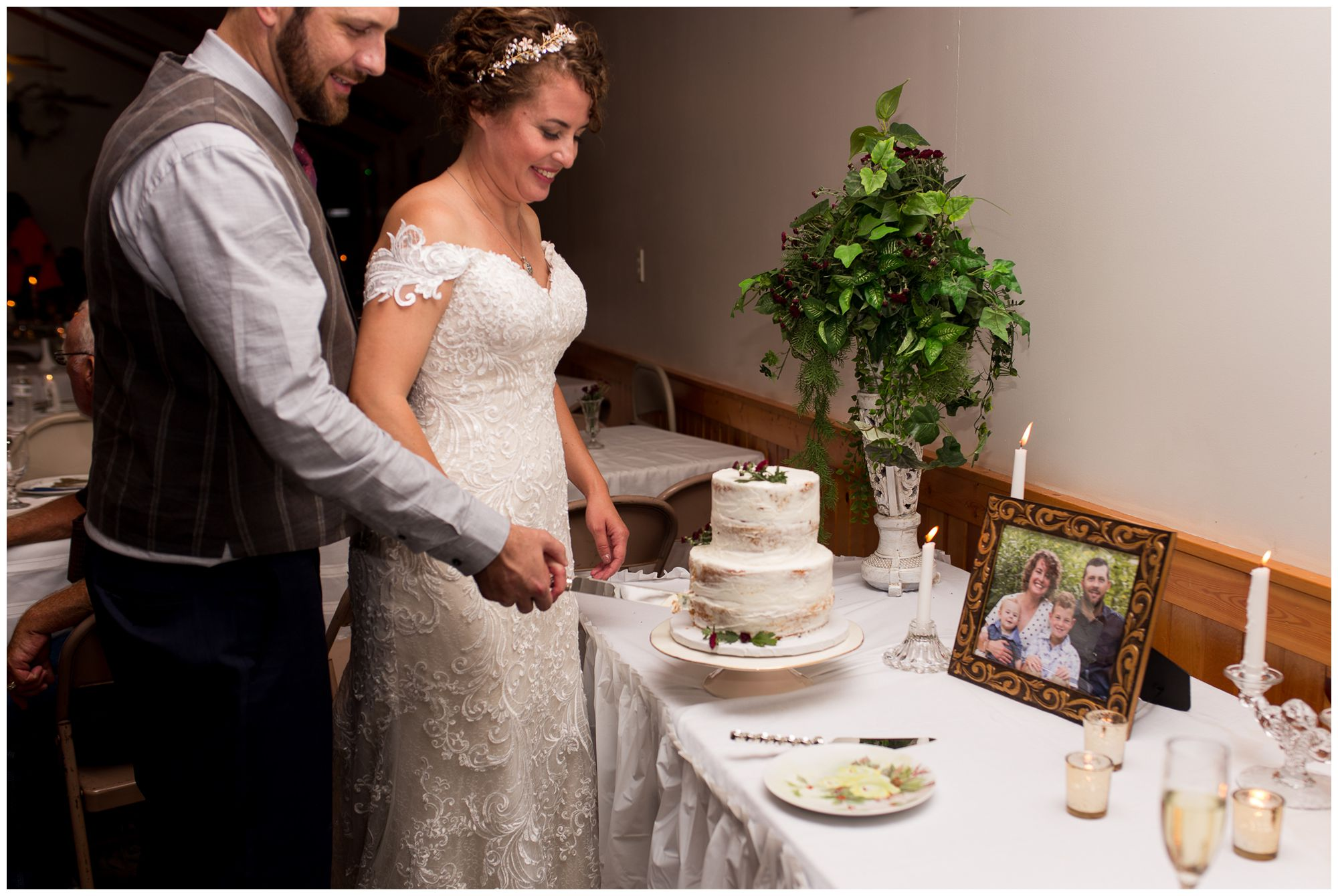 bride and groom cut cake during wedding reception in Peru Indiana
